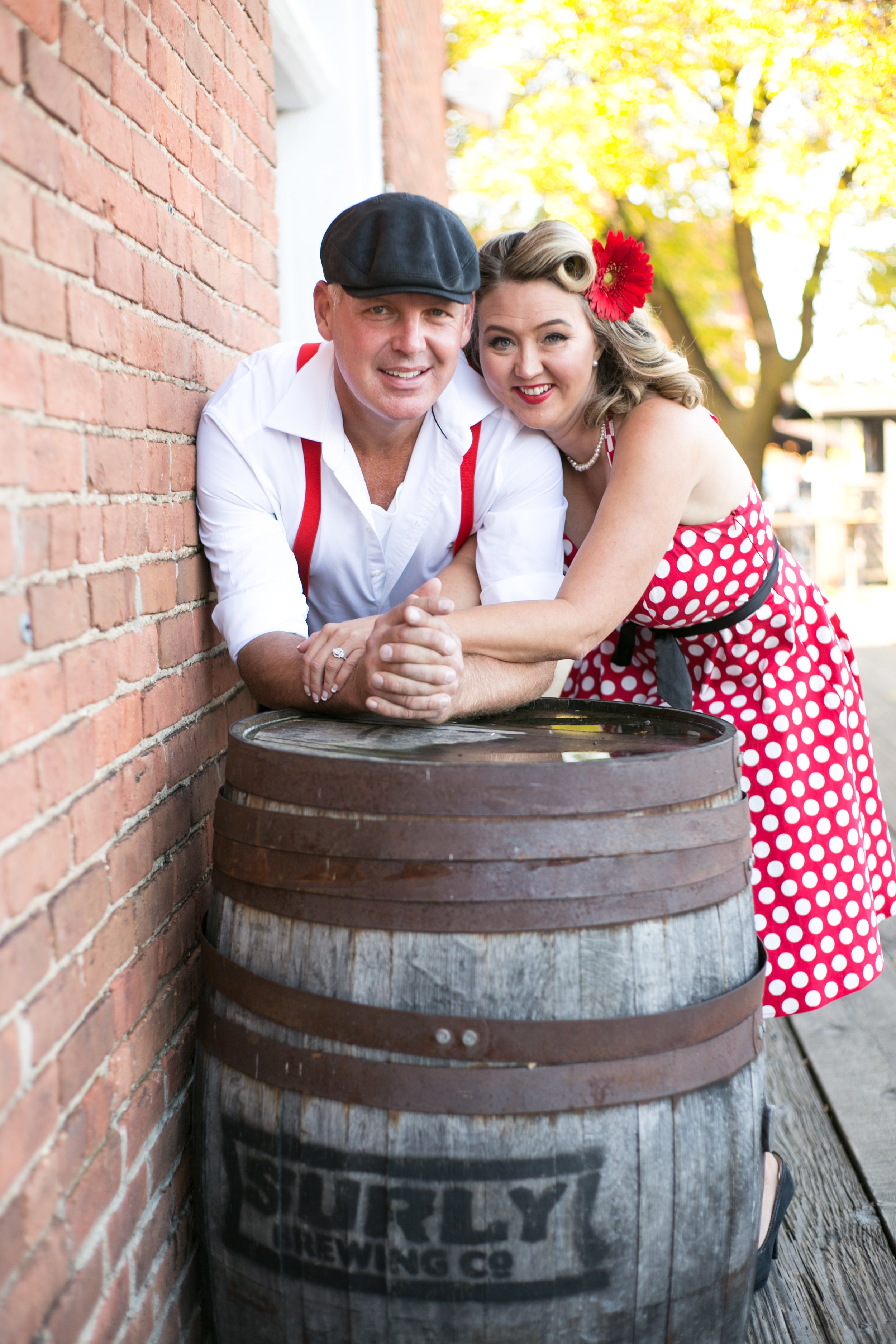 Vintage engagement shoot couple holding hands in Stillwater MN