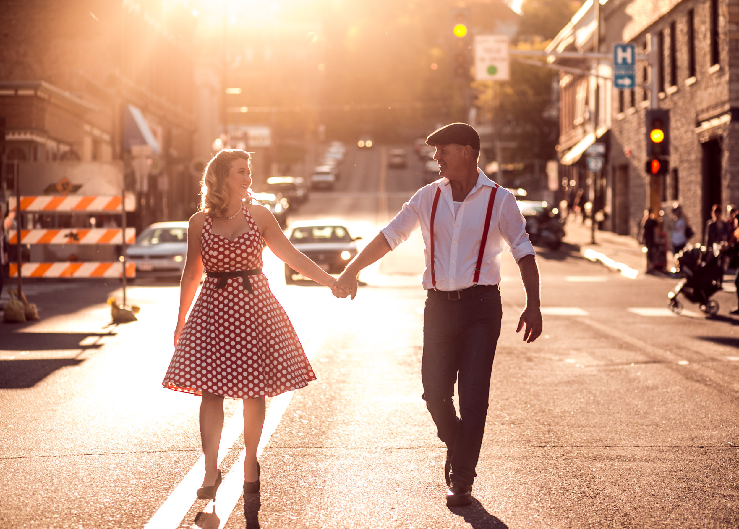 A couple dances in the golden light sunset in Stillwater MN street