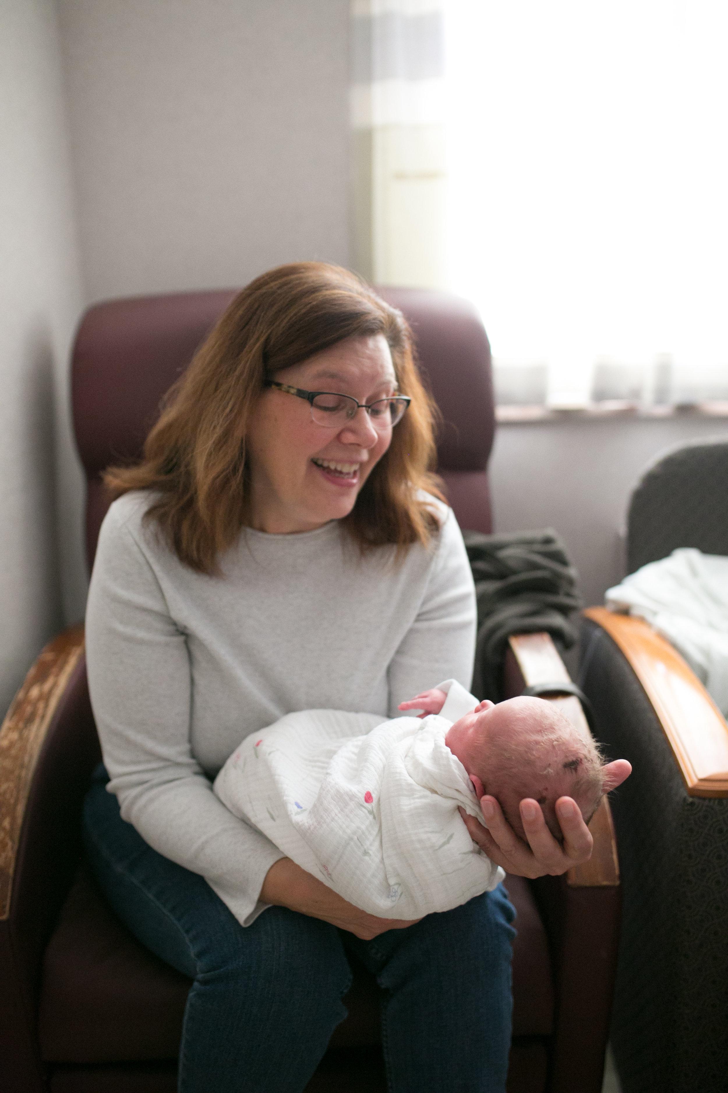 grandma kummer holds newborn baby girl marshfield