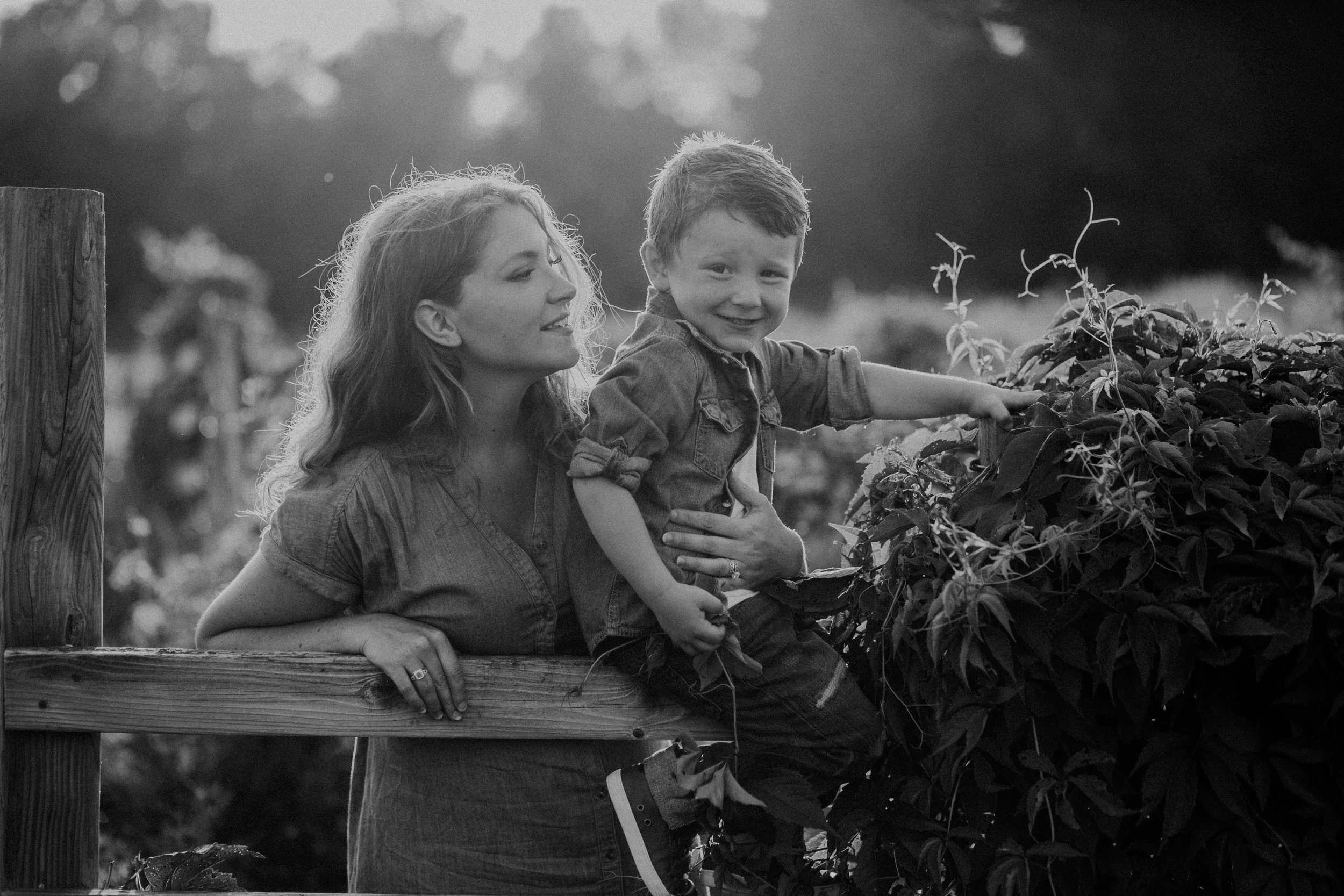 black and white lifestyle image of mom and son in River Falls