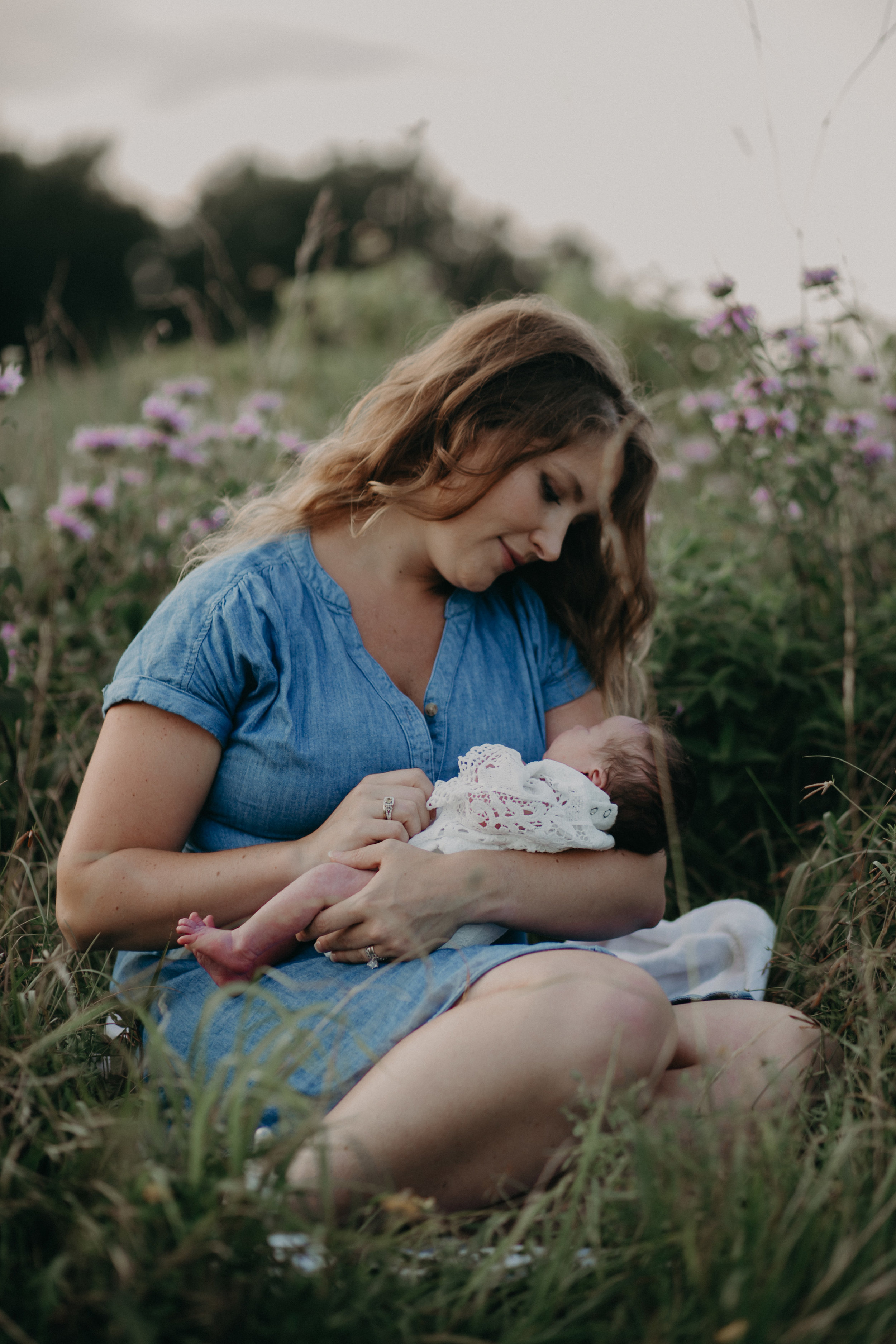 Mommy and baby girl in field of flowers