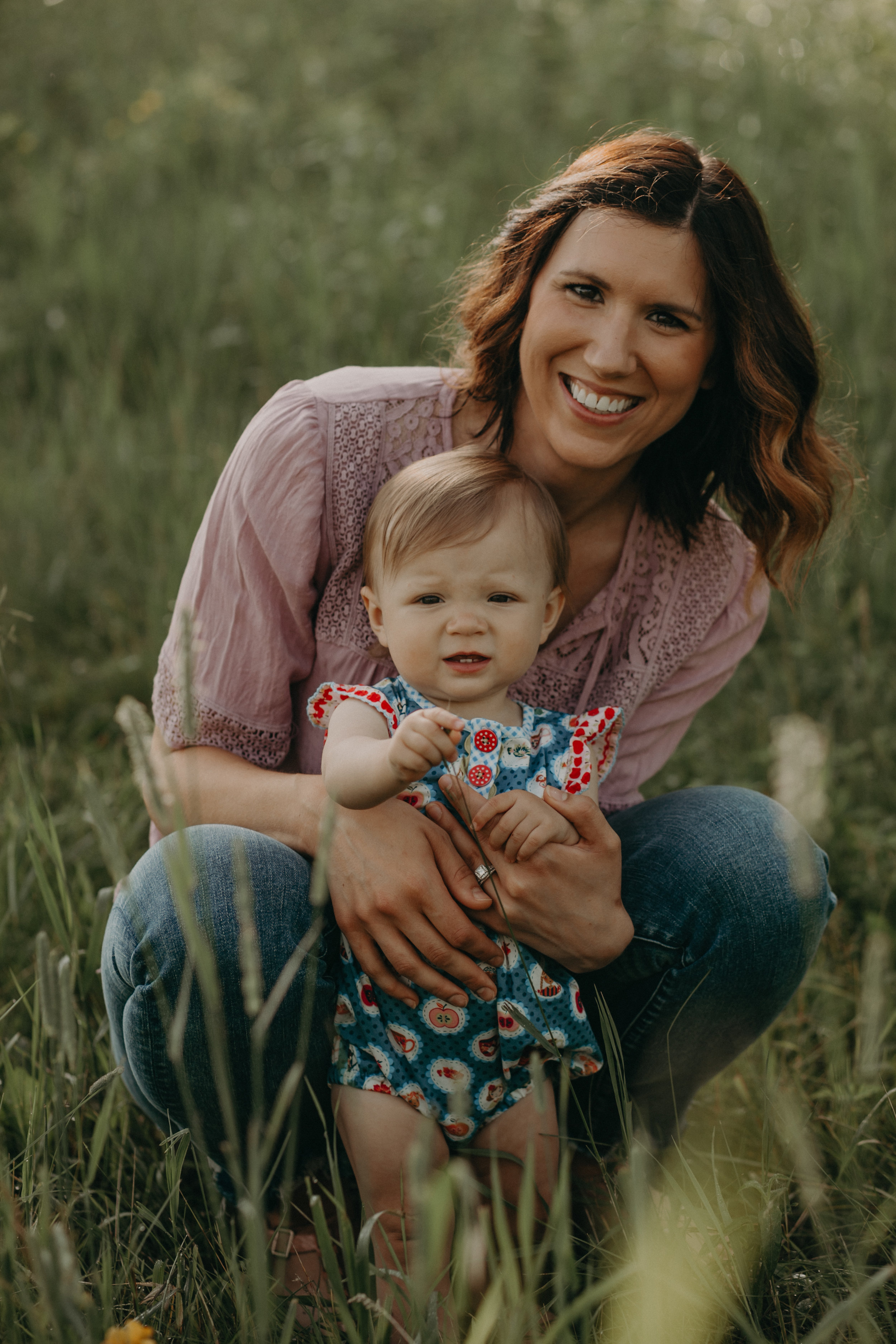 mommy and infant daughter smiling at the camera for Andrea Wagner Photography