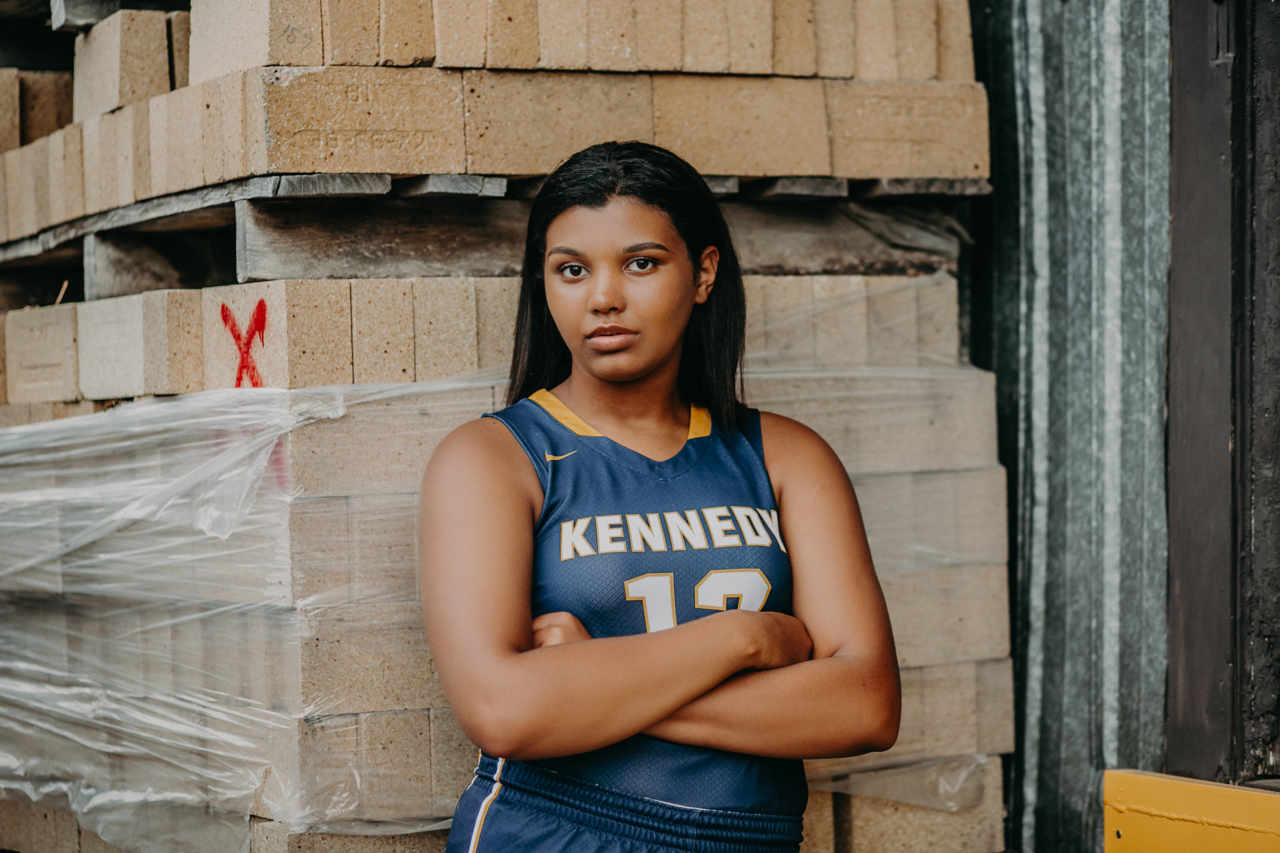 black female basketball player from Bloomington Kennedy High School posing in Hudson WI for her senior photo session