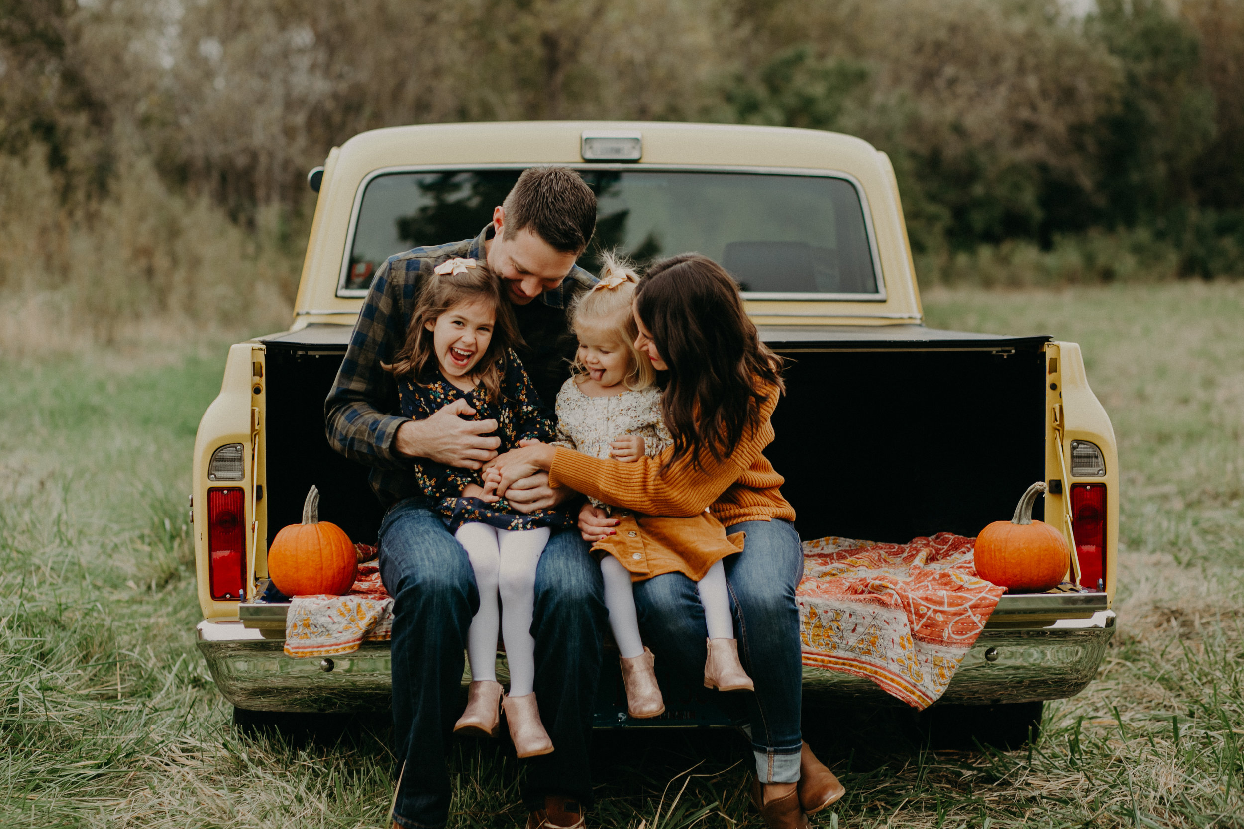 River Falls lifestyle family session sitting on a vintage truck