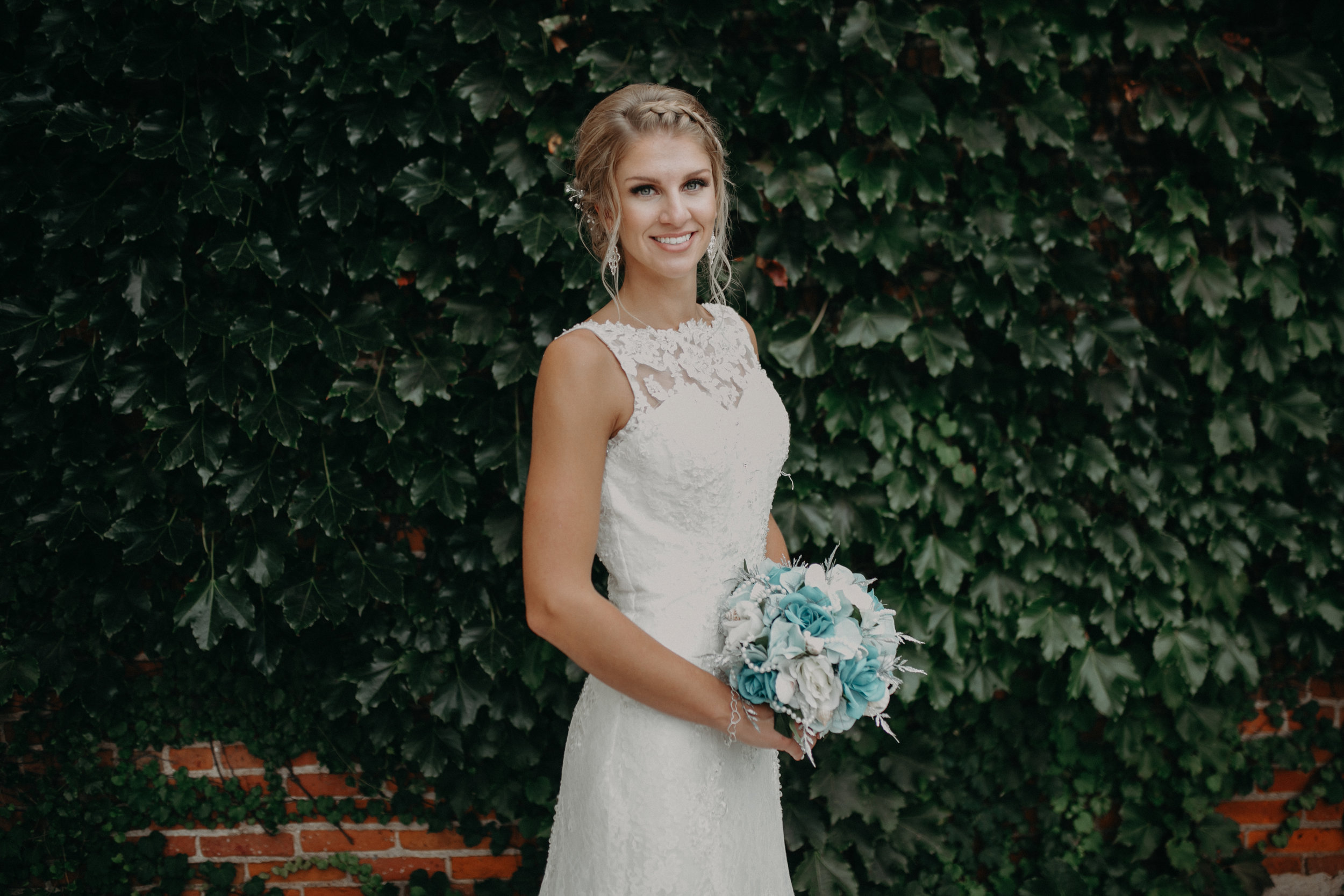 Andrea Wagner Photography with Tiffany Lenz at her wedding in Marshfield WI by Thomas House