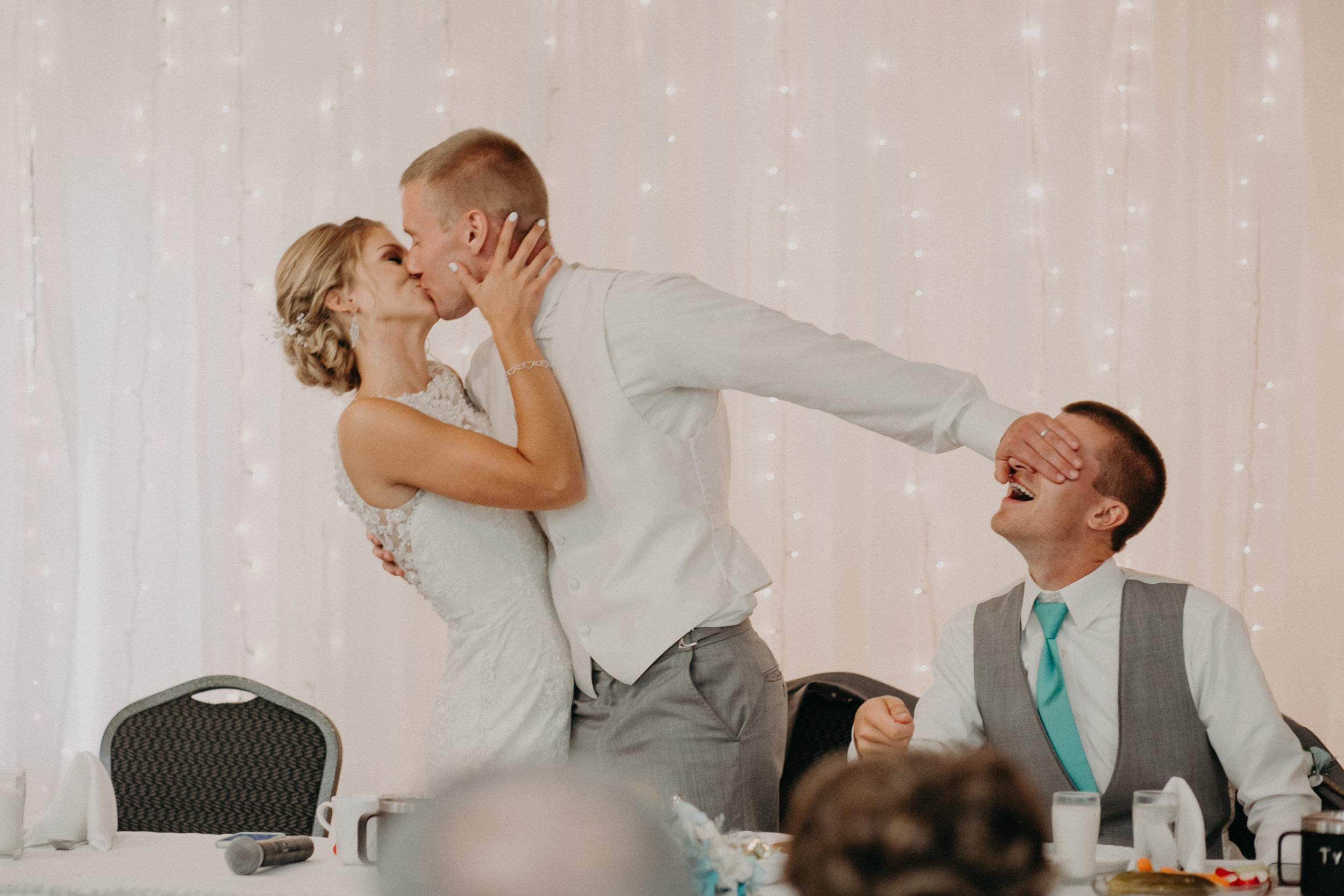 lenz-stargardt-wedding-reception-eagles-club-kissing-bride-groom