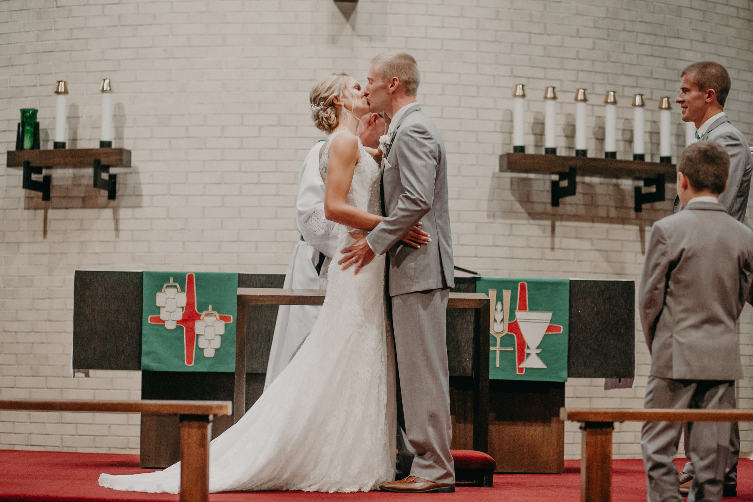 bride and groom's first kiss at Christ Lutheran Church in Marshfield WI