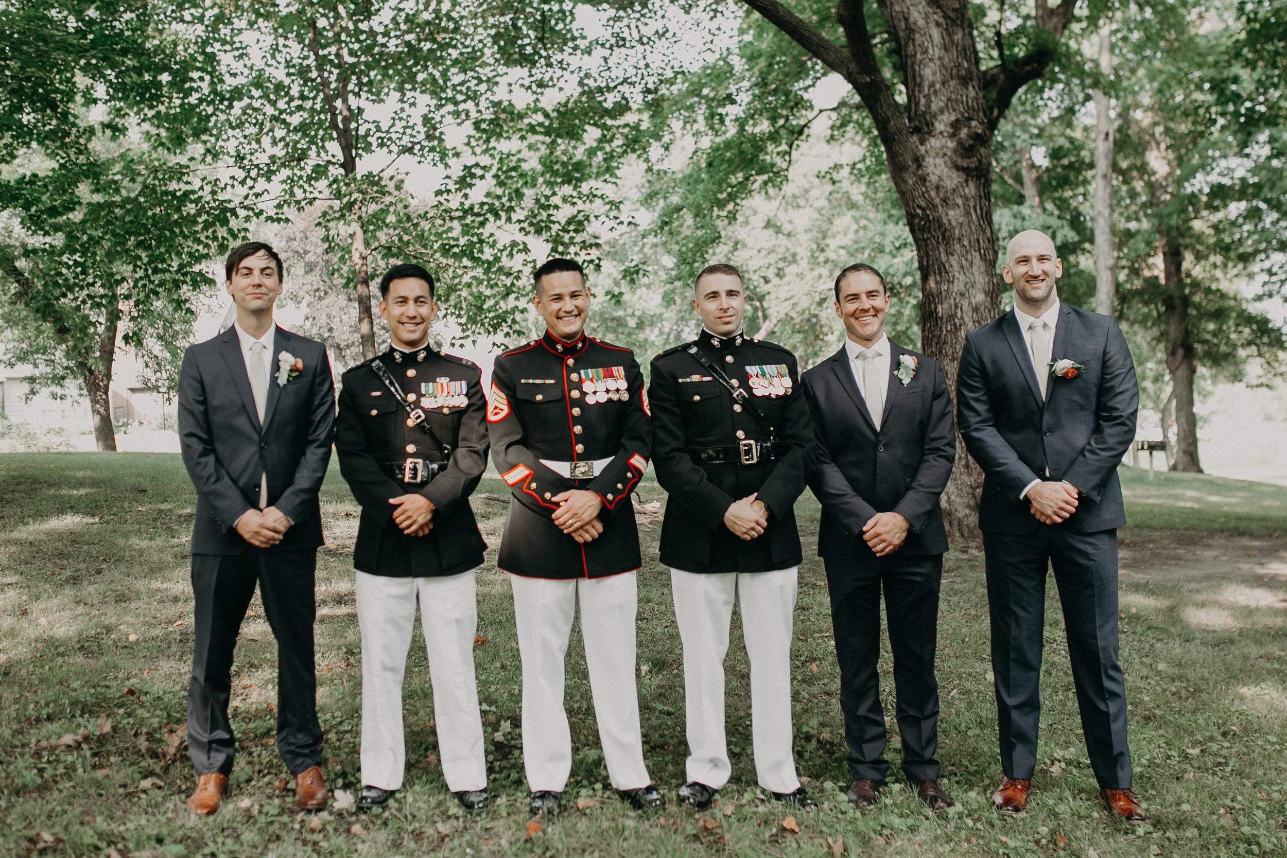 military groom and groomsmen pose for wedding portraits at 6Smith on Lake Minnetonka