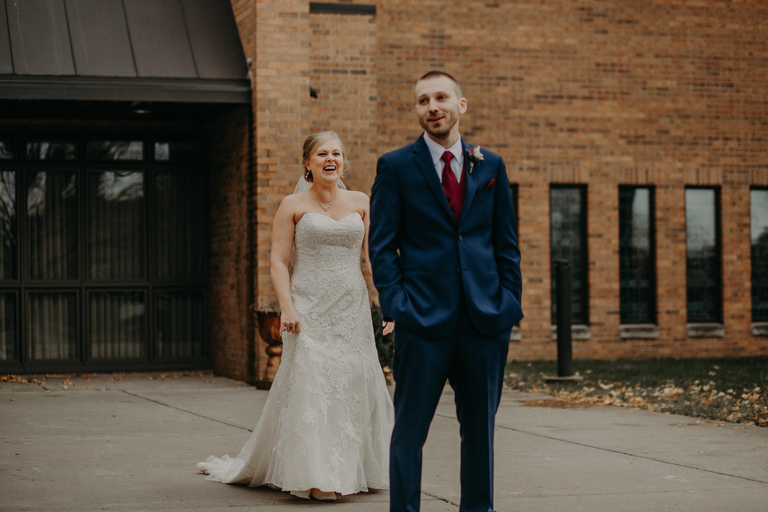 first-look-wedding-river-falls-catholic-church