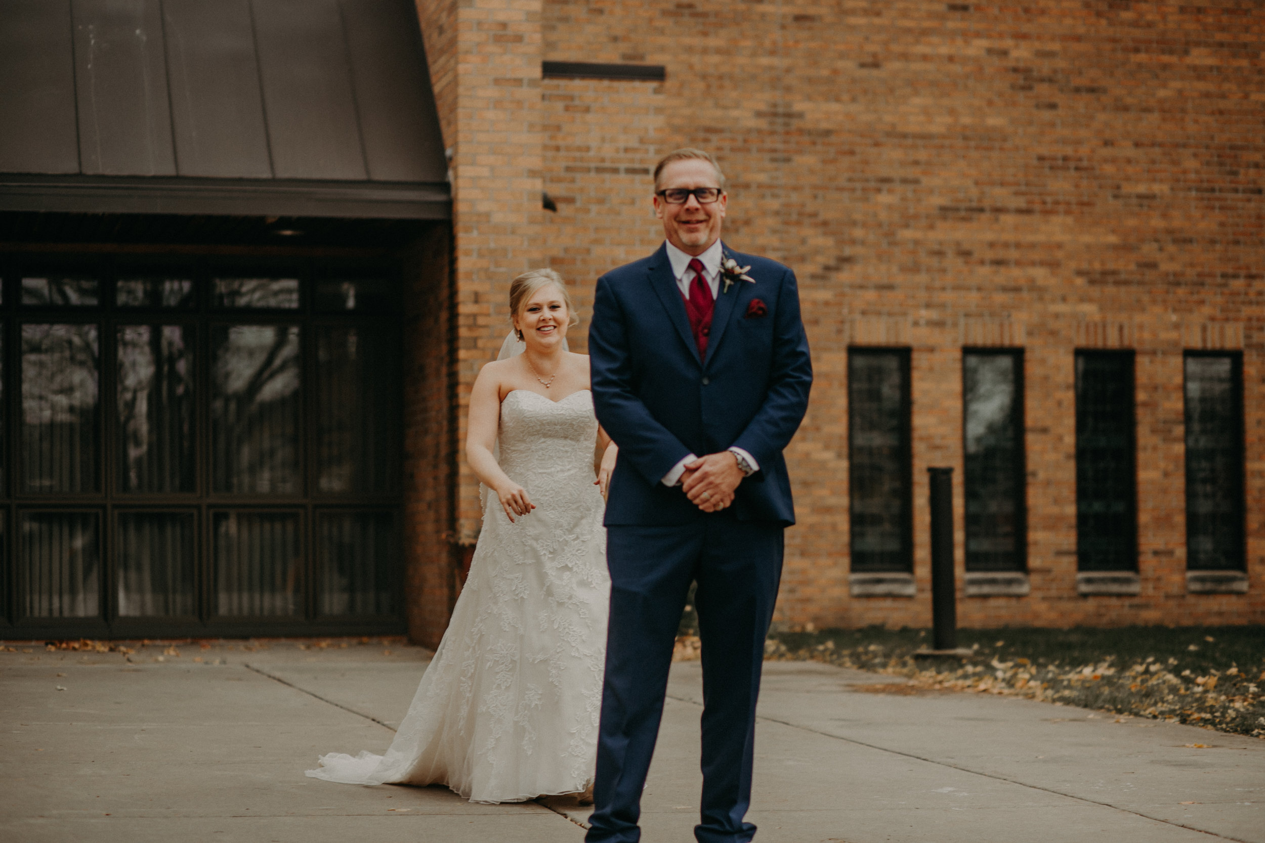 bride does a first look with her father at wedding in River Falls WI