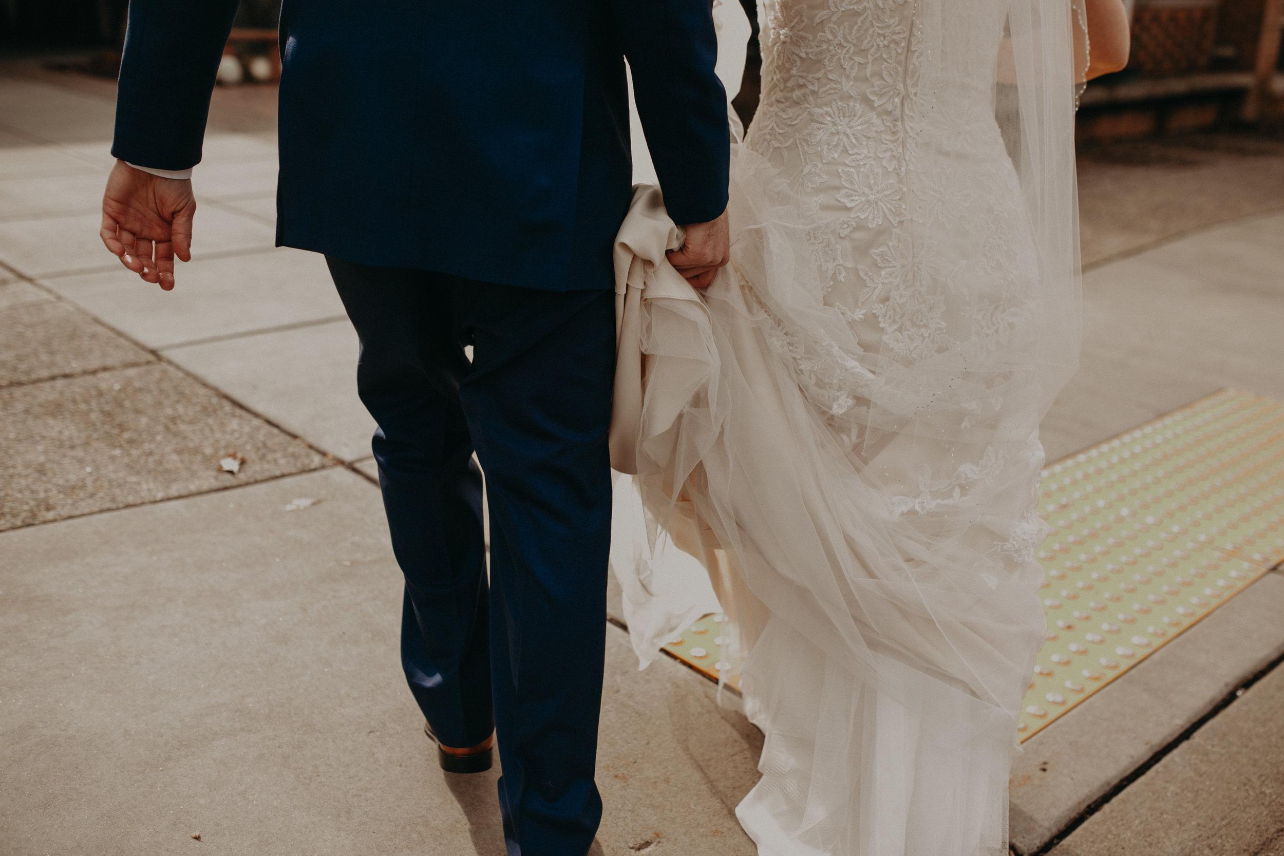 groom-carrying-wedding-dress-river-falls