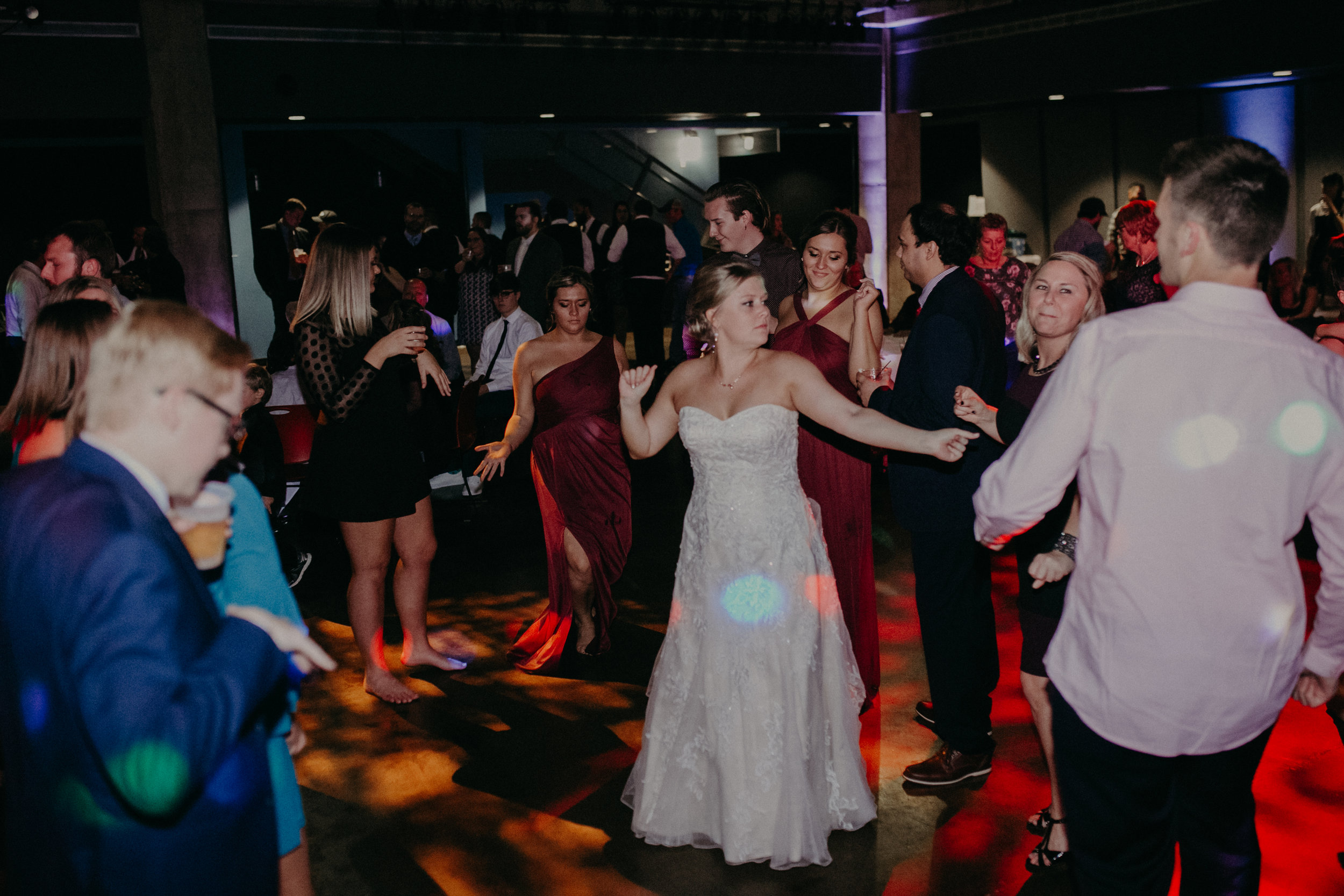 bride dances on the dance floor at University of Wisconsin River Falls Falcon room