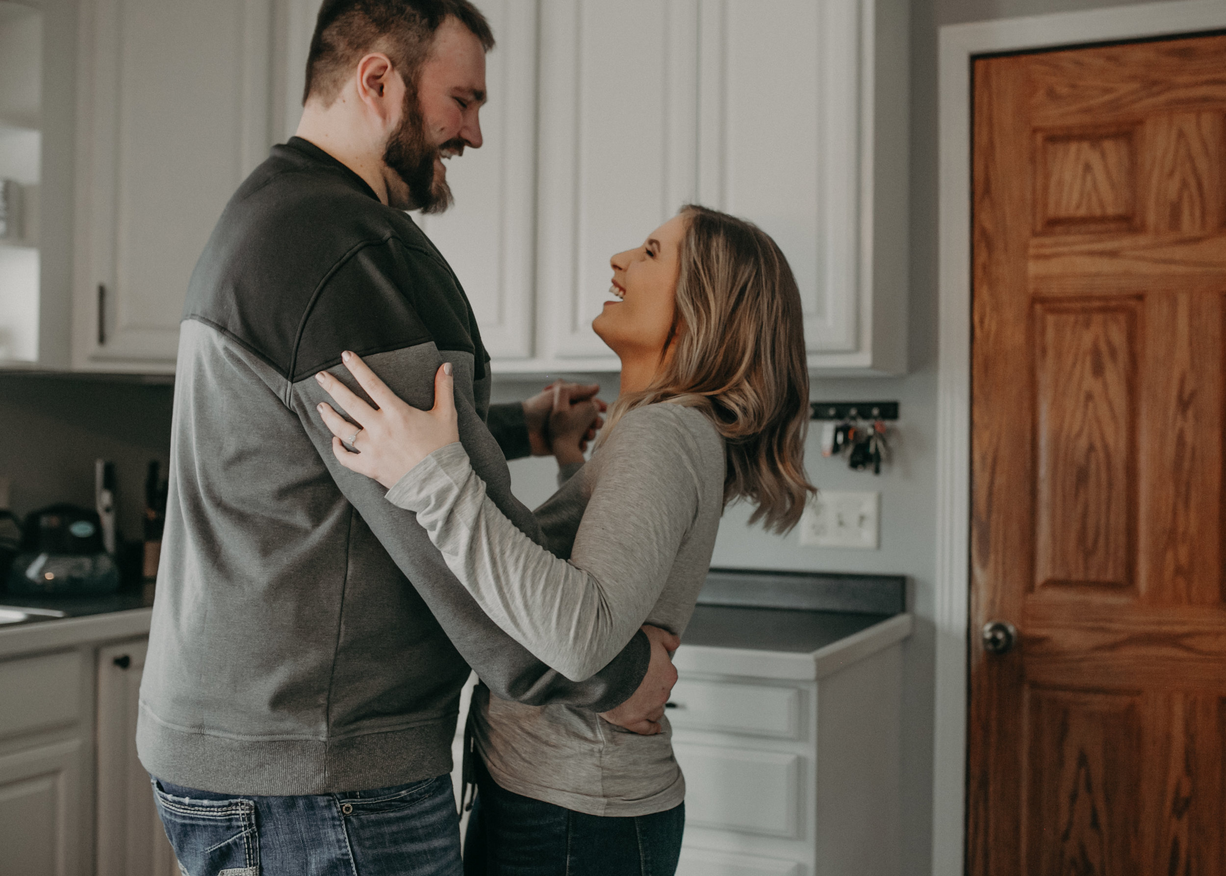 photos of a couple dancing in their kitchen by engagement photographer Andrea Wagner in Athens WI