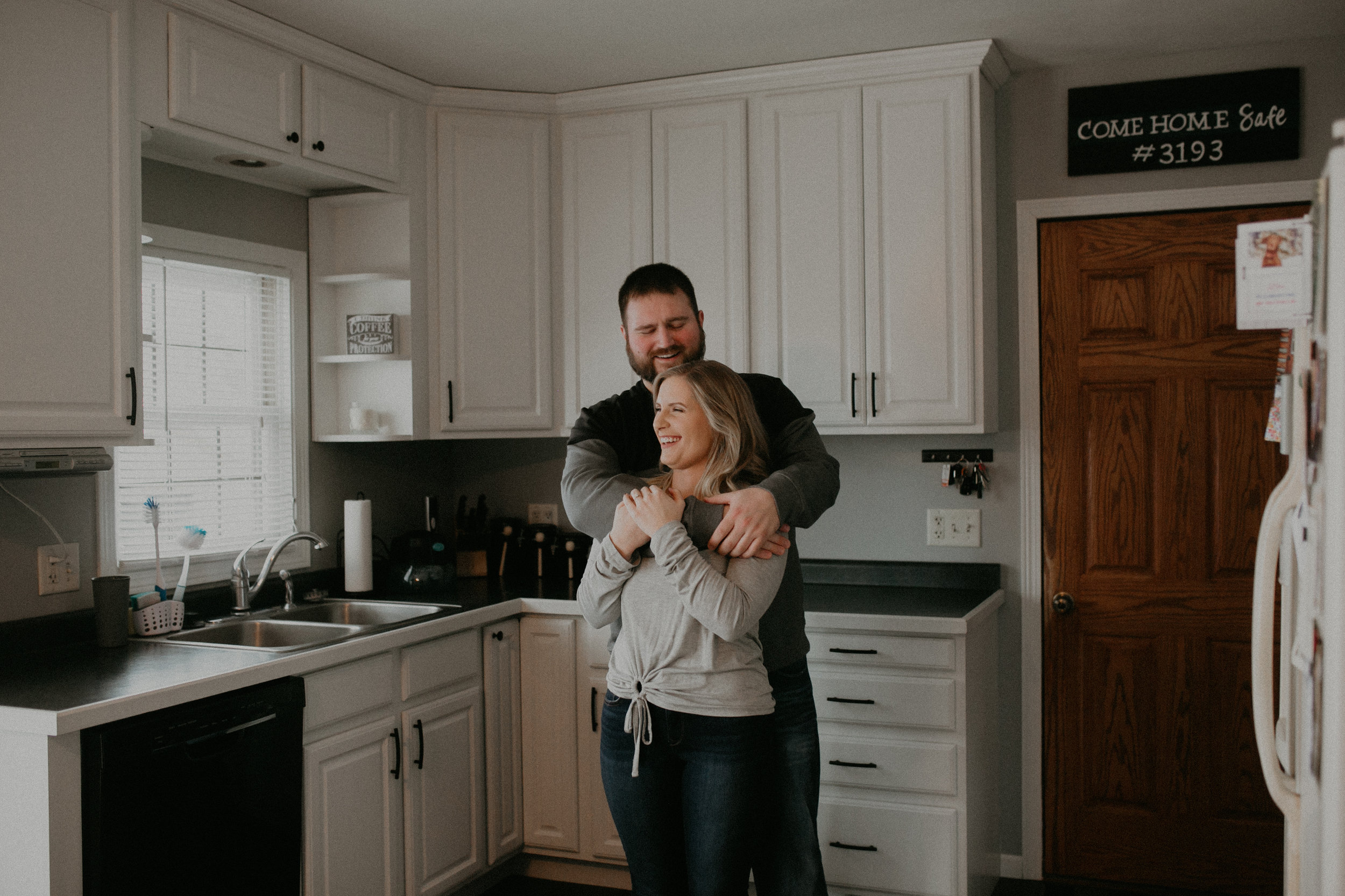 engagement session in kitchen in Athens WI