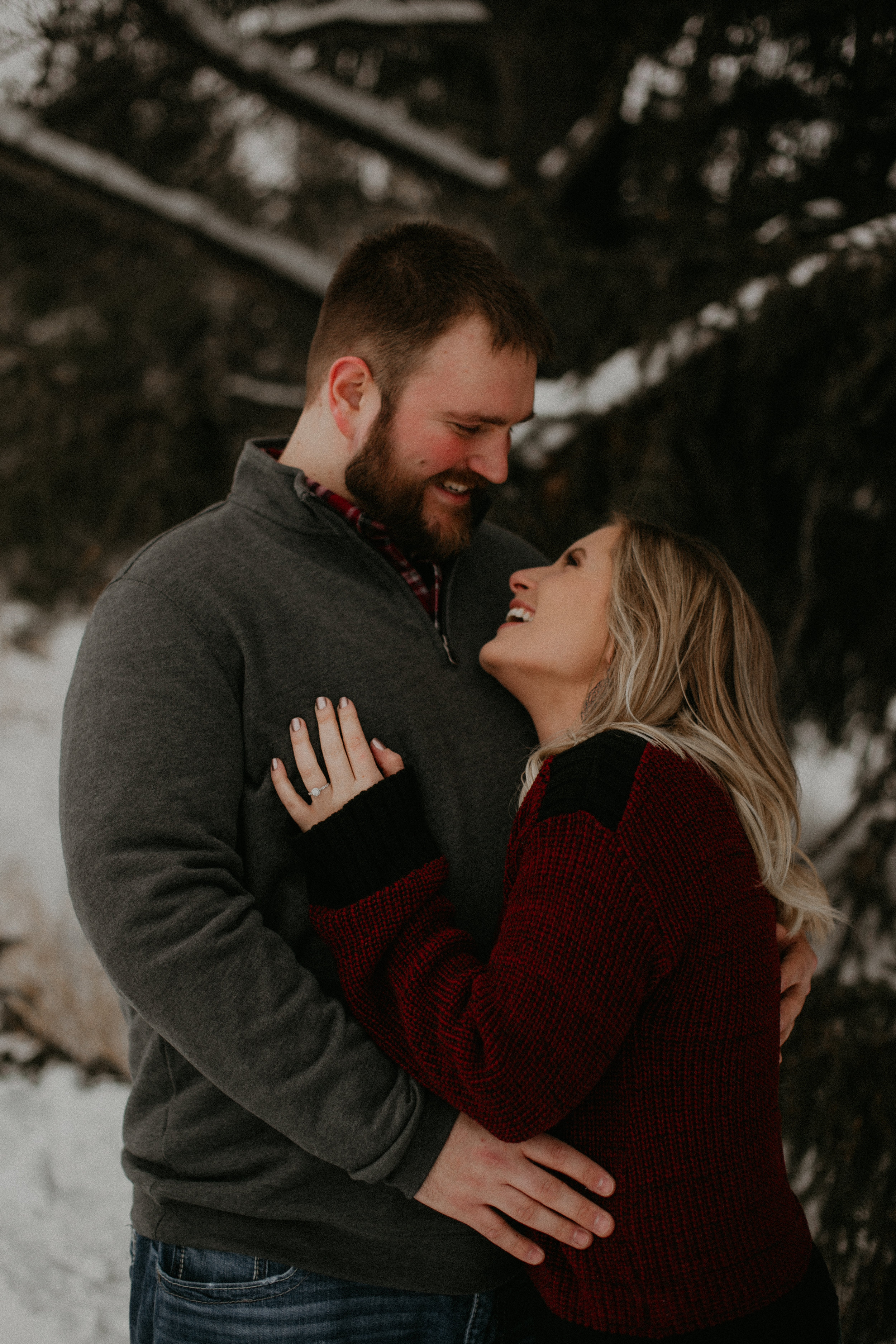 Athens WI couple snuggles in the snow during a winter engagement session