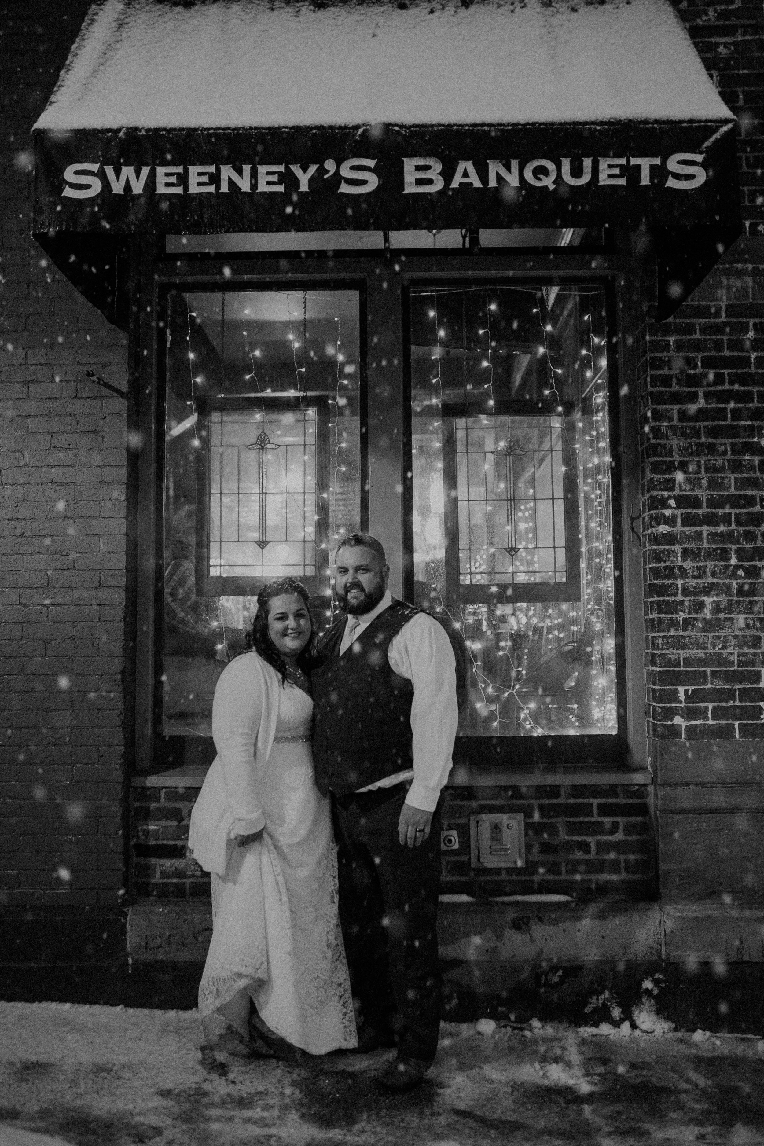 Just Married in front of Sweeney's Saloon in the middle of a snowstorm