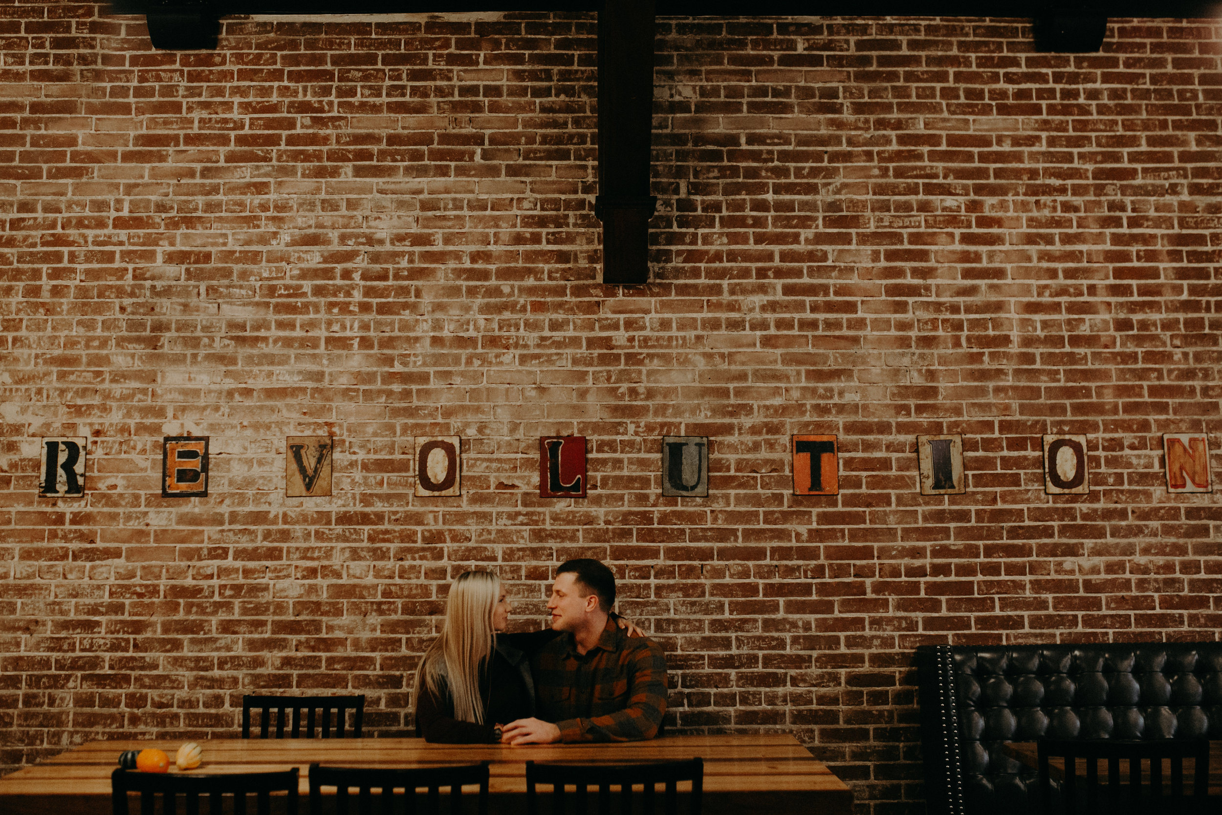 a hipster engagement session for a Wisconsin couple at Revolution Coffee in Black River Falls