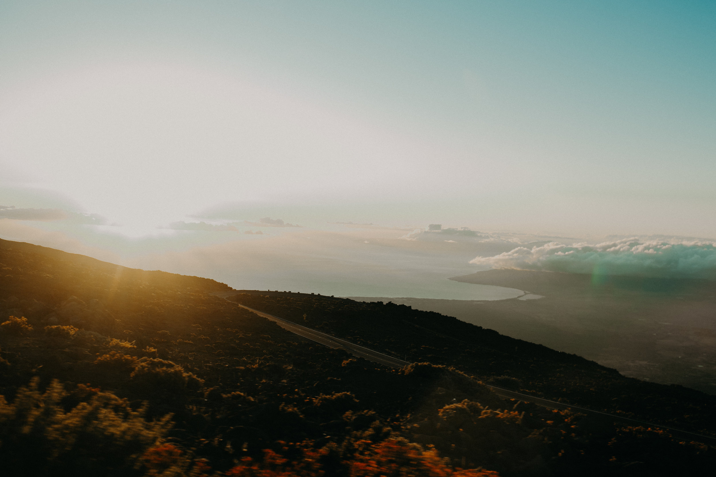 The sun sets from Haleakala Volcano over the north shore of Maui Hawaii