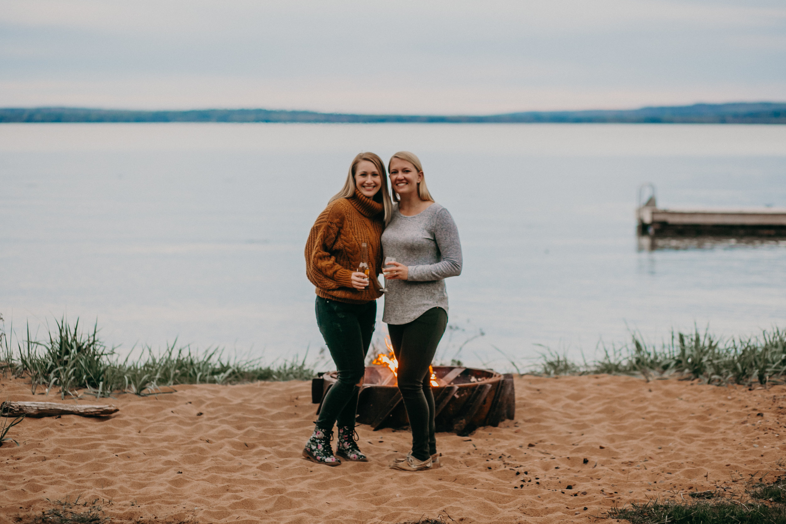 friends hanging on the beach with a campfire on Madeline Island