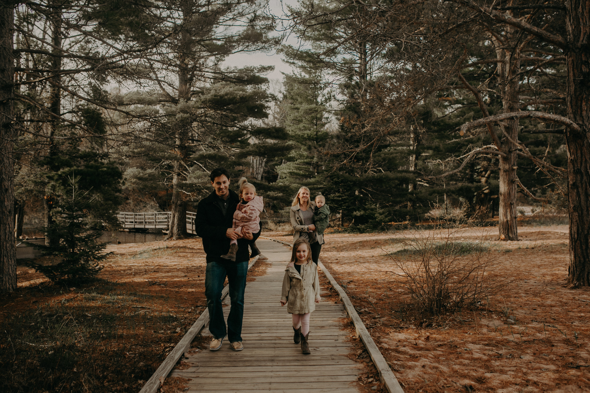 family walking through Big Bay Town Park on Madeline Island for a family photo shoot