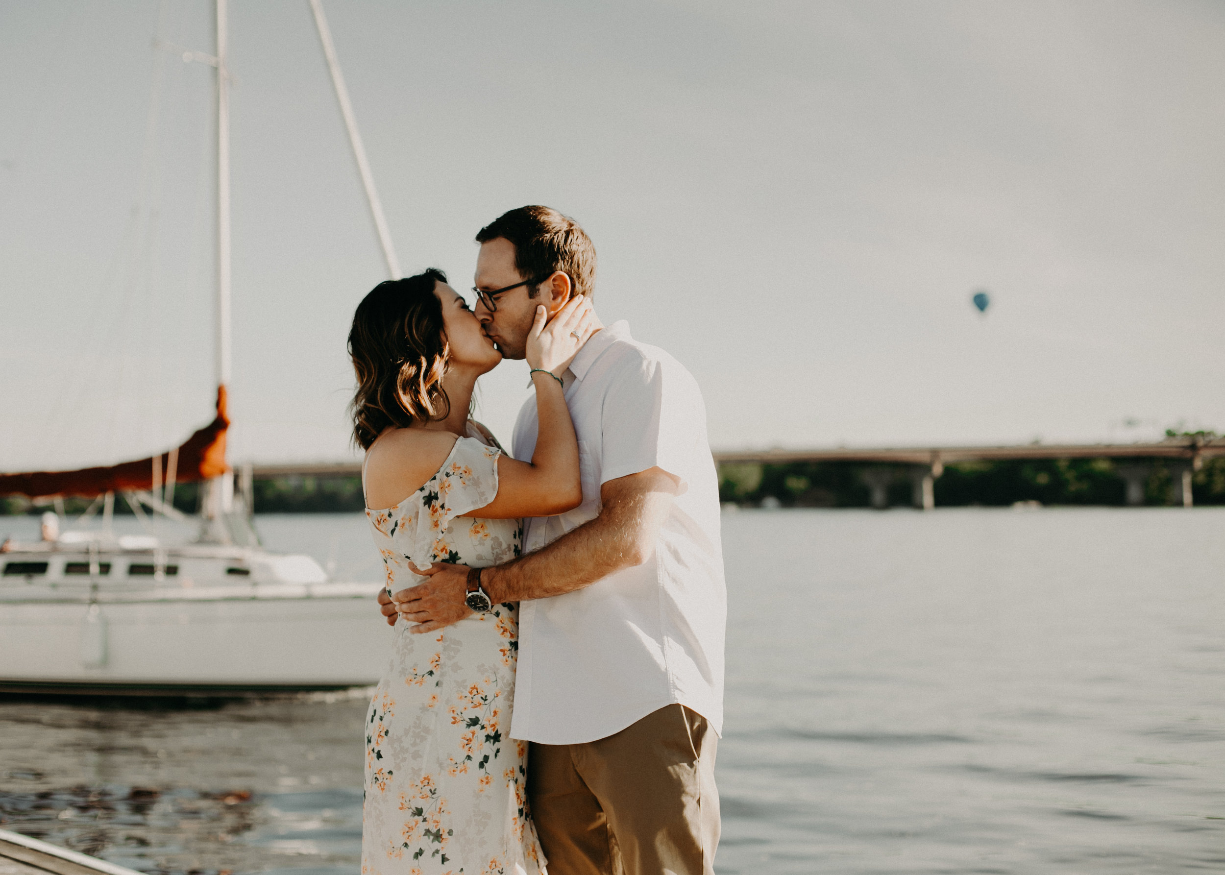 Andrea Wagner Photography captures real and intimate moments between an engaged couple in Hudson WI at the St Croix Marina