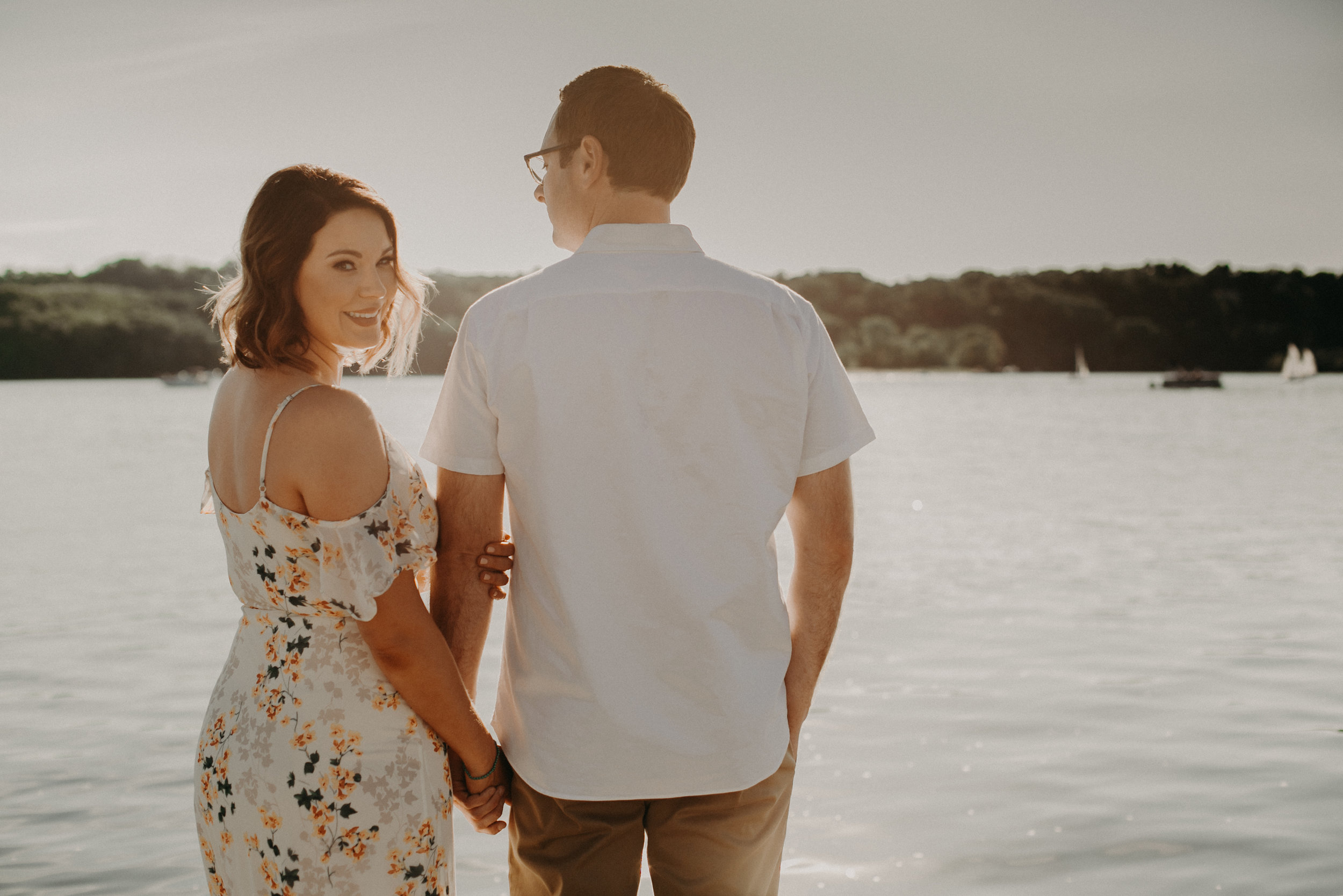 a beautiful couple poses for engagement pictures on the St Croix River in Hudson WI