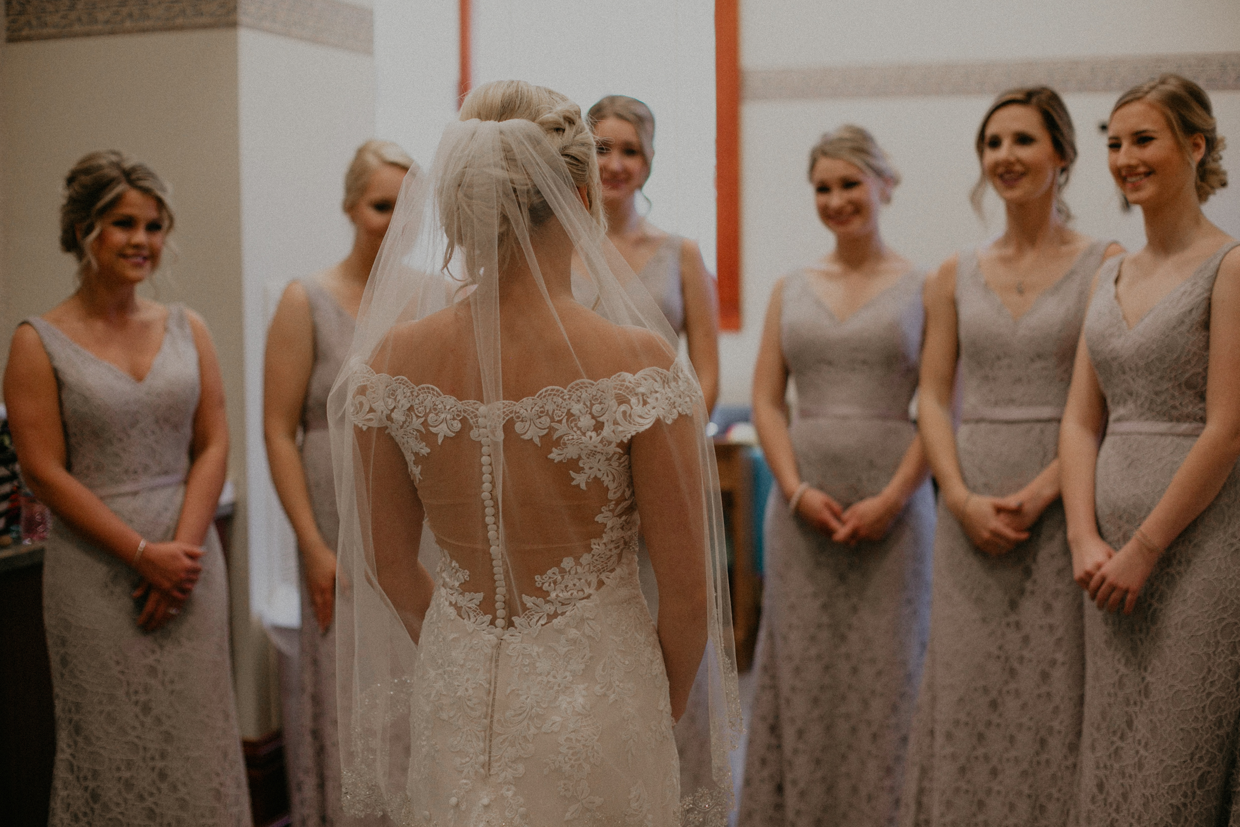 bridesmaids have first look with their bride in Marshfield WI wedding