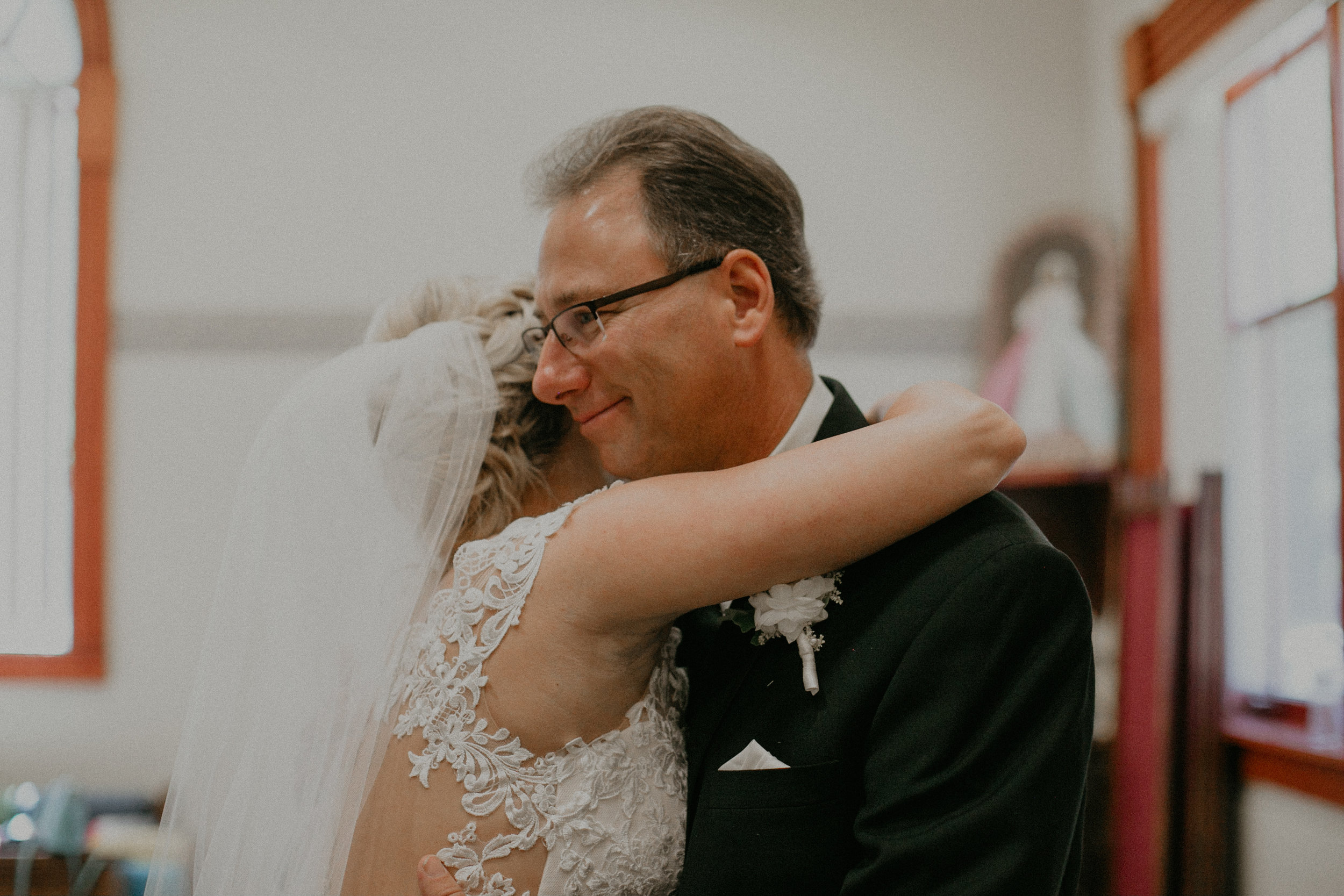 real and authentic moment of bride hugging her dad before her wedding in Marshfield WI