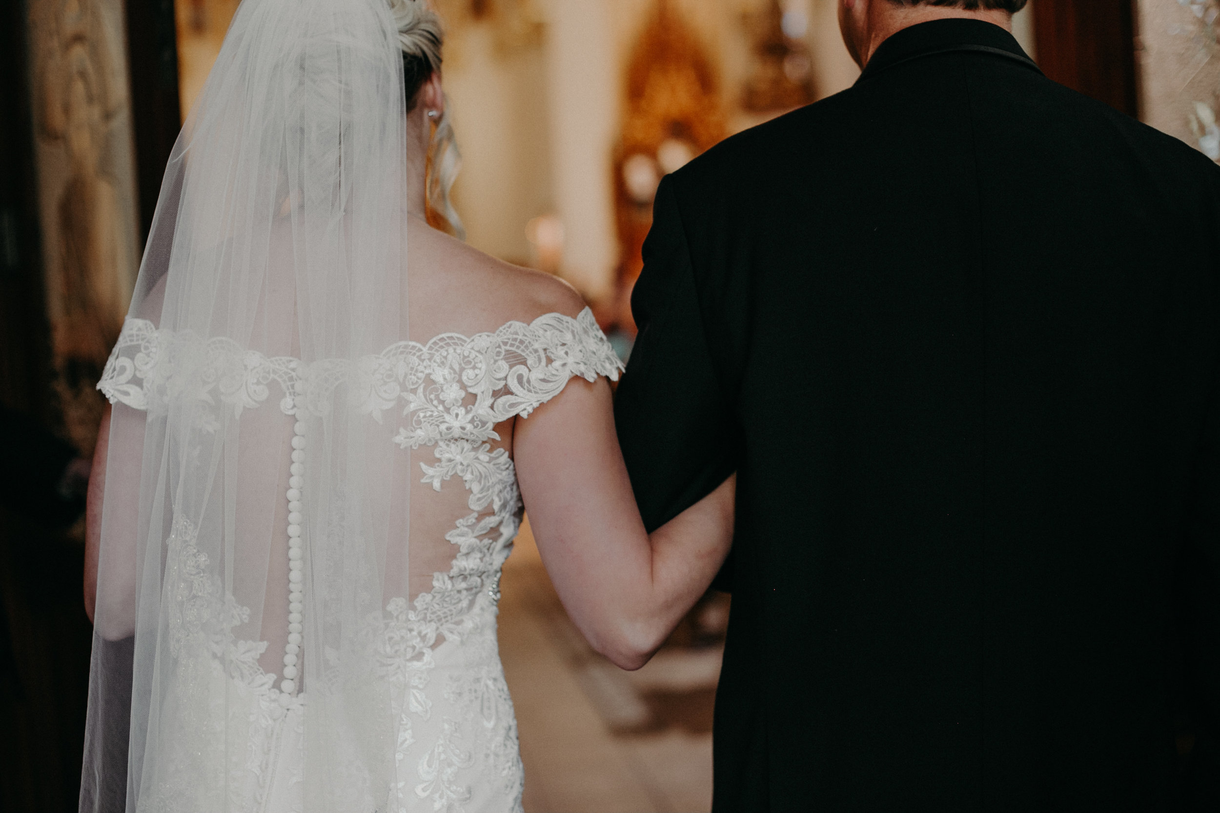 Marshfield WI wedding photographer Andrea Wagner captures bride walking down the aisle to her groom