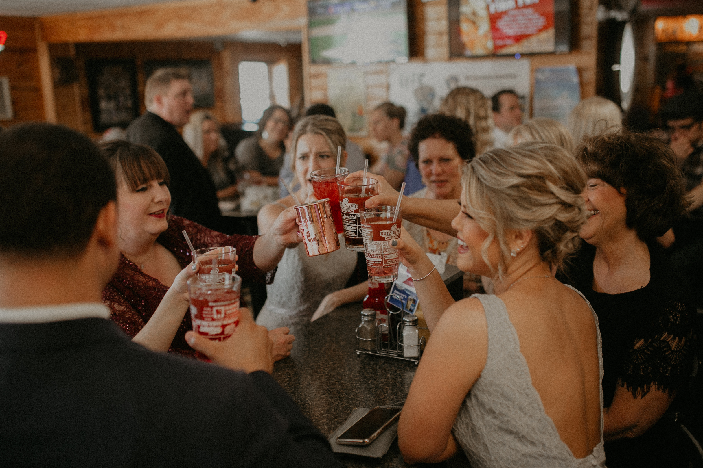 candid shot of wedding party toasting at Nutz Deep II in Marshfield WI