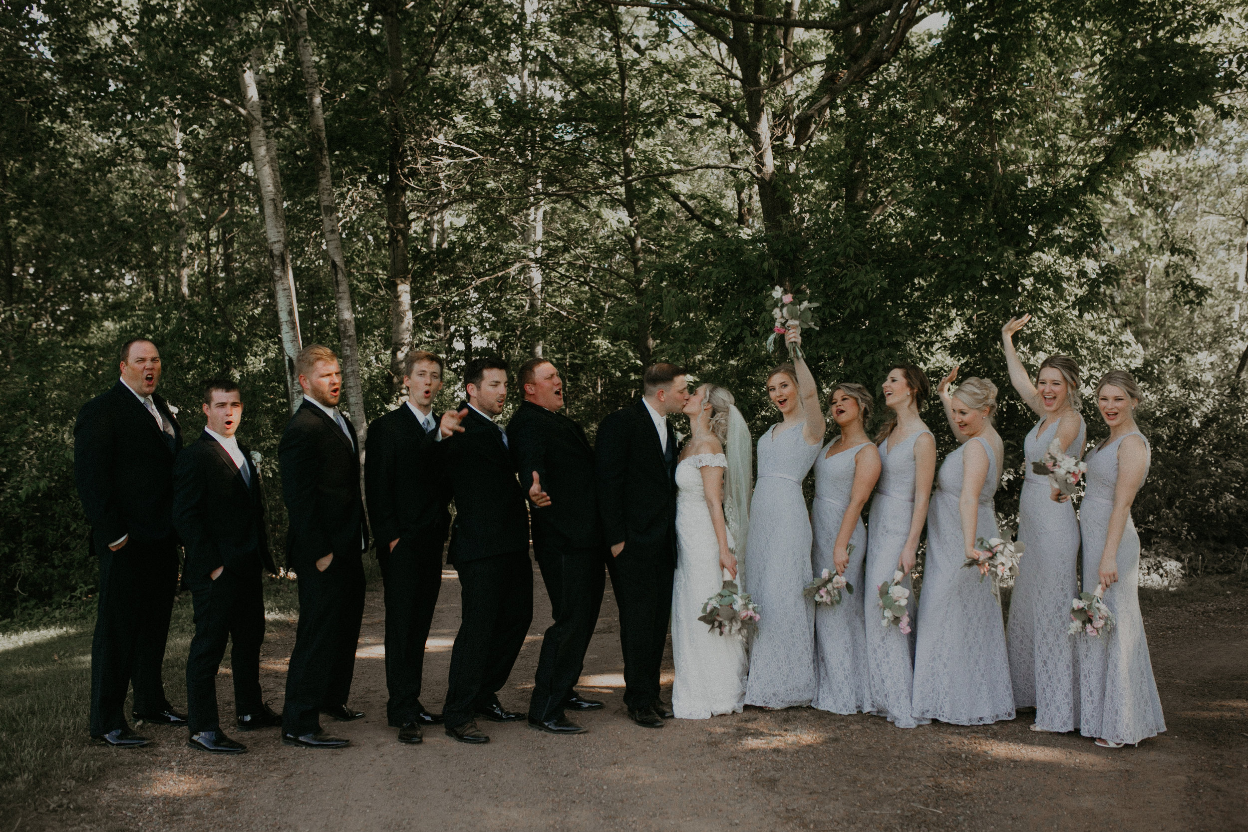 bridal party poses for photographs at RiversEdge Golf Course in Marshfield WI
