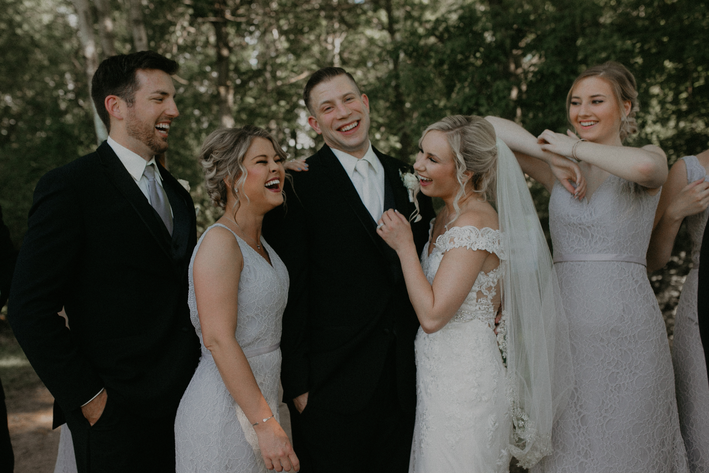 Andrea Wagner Photography captures real and authentic moments of the bridal party at RiverEdge Golf Club in Marshfield Wi