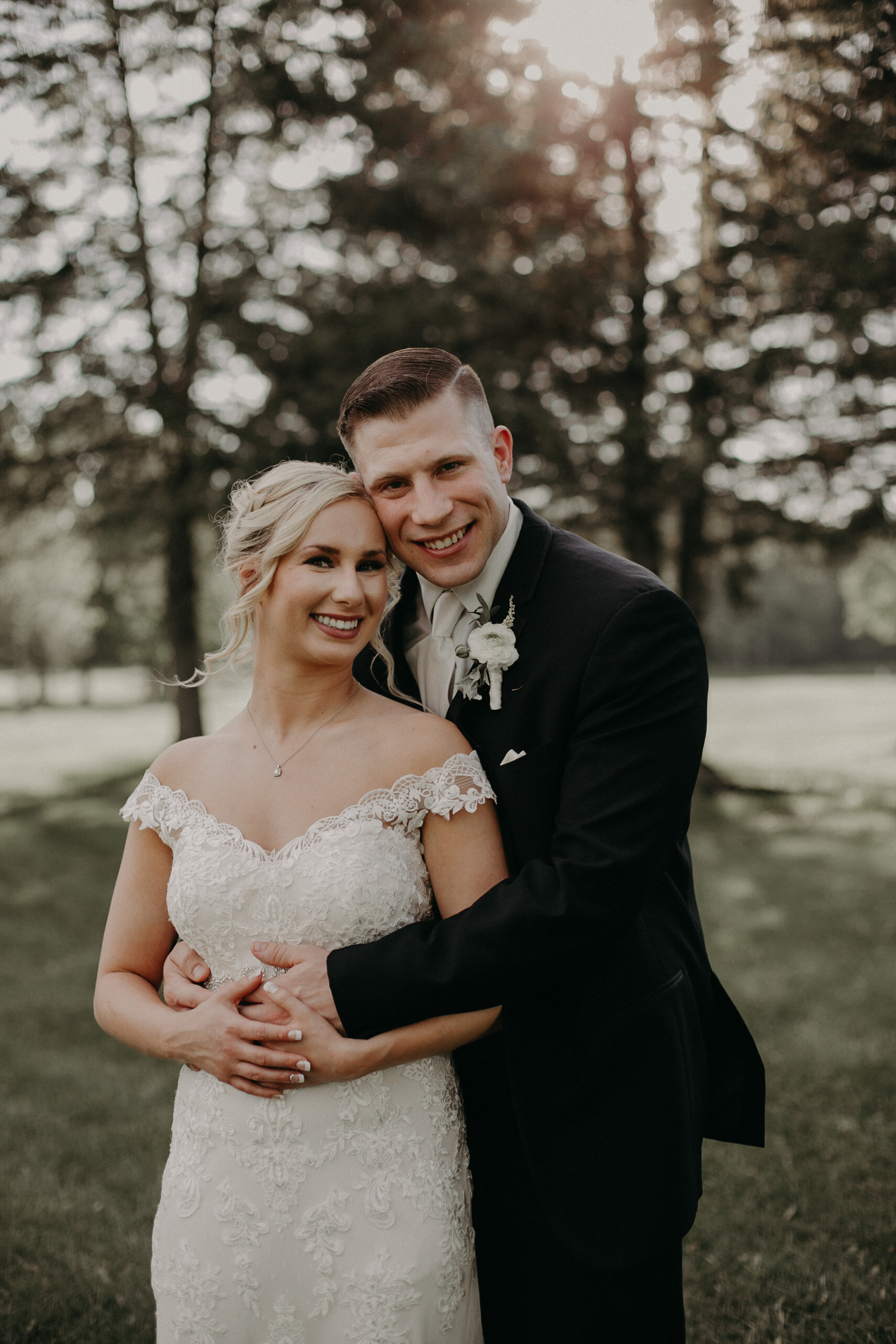 sunset photos of wedding couple in Marshfield WI at RiverEdge Golf Club
