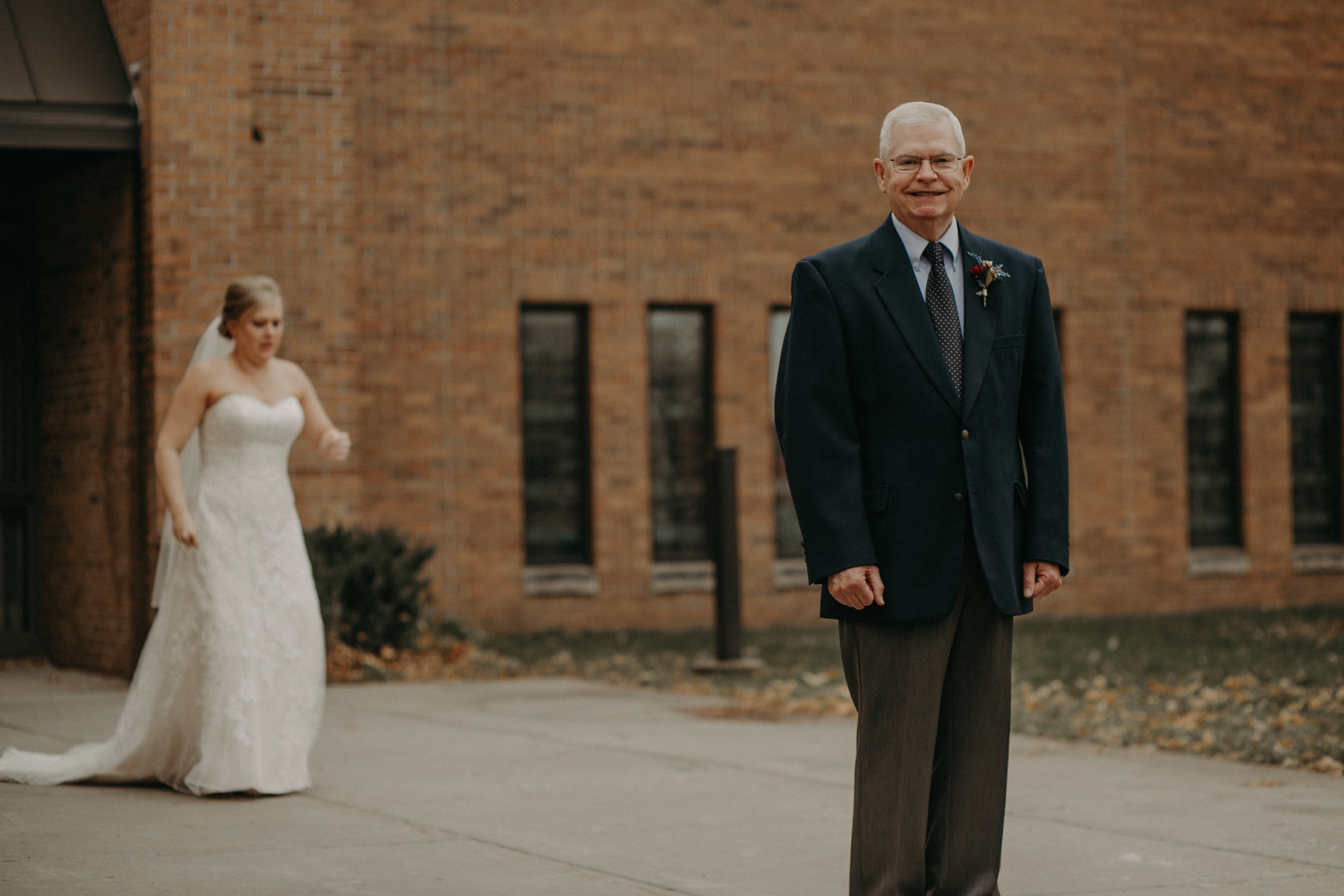 emotional first look between a bride and her grandfather at St Bridgets Church in River Falls WI