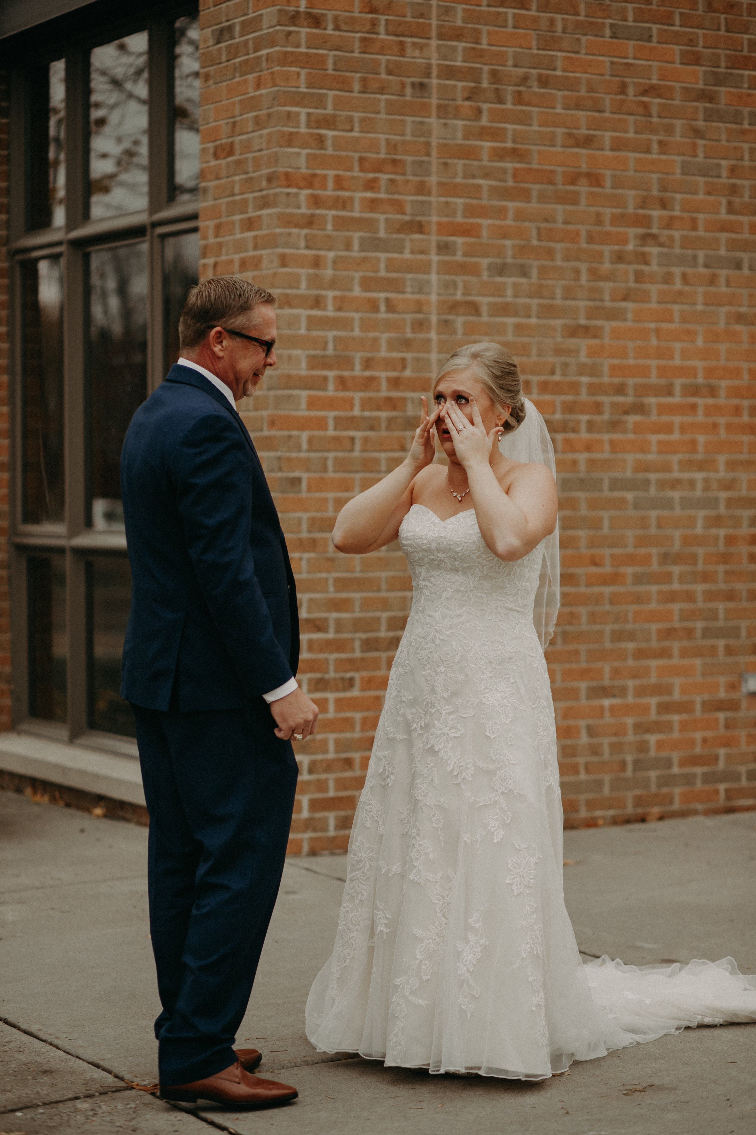 River Falls WI wedding photographers captures an emotional first look between father and bride