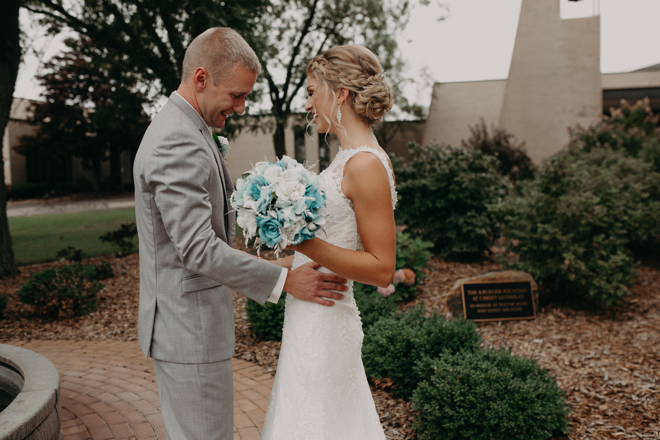 wedding photographer Andrea Wagner captures a joyful first look before Marshfield WI wedding