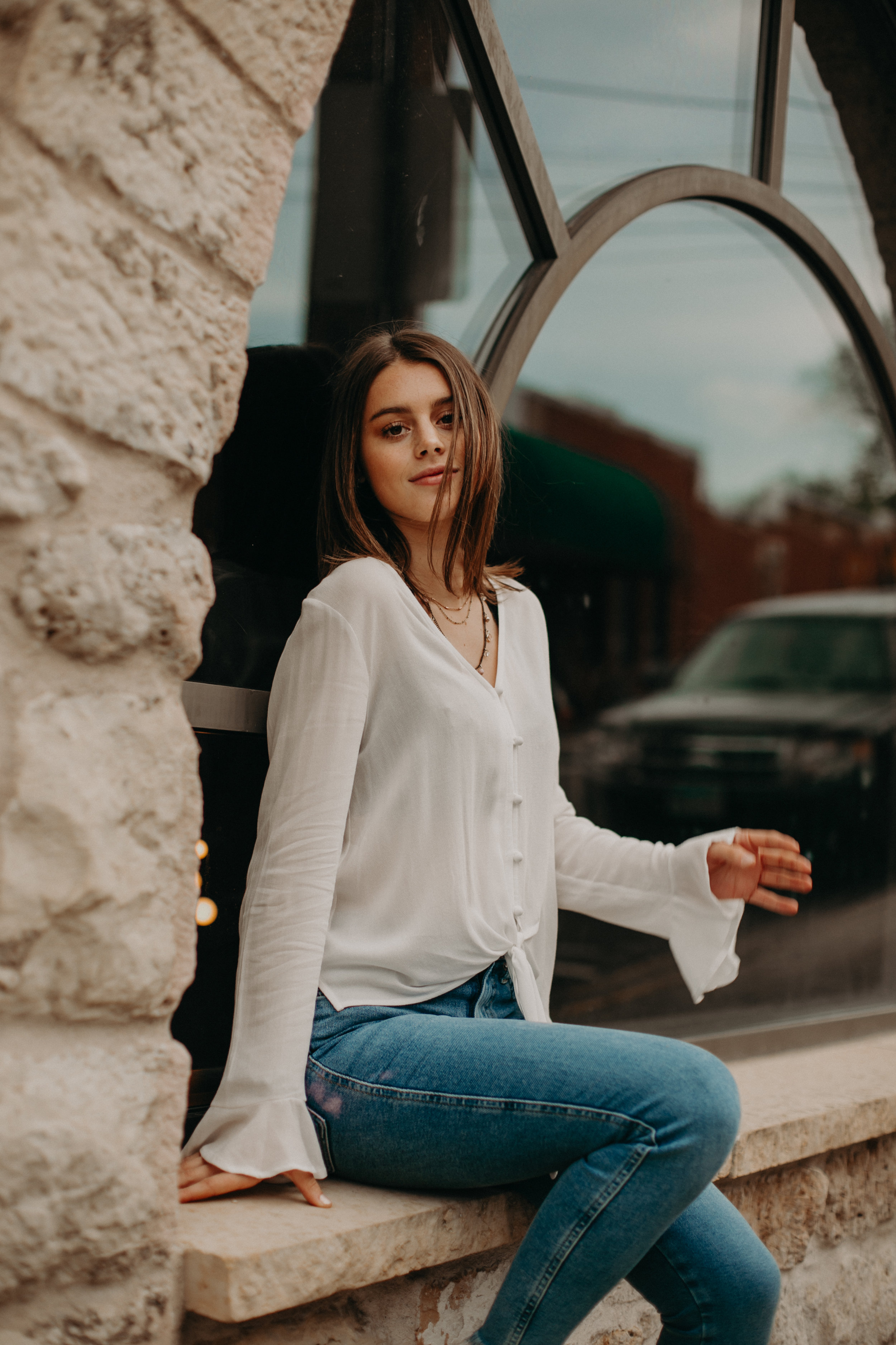 beautiful girl poses for her senior photos in downtown Stillwater MN