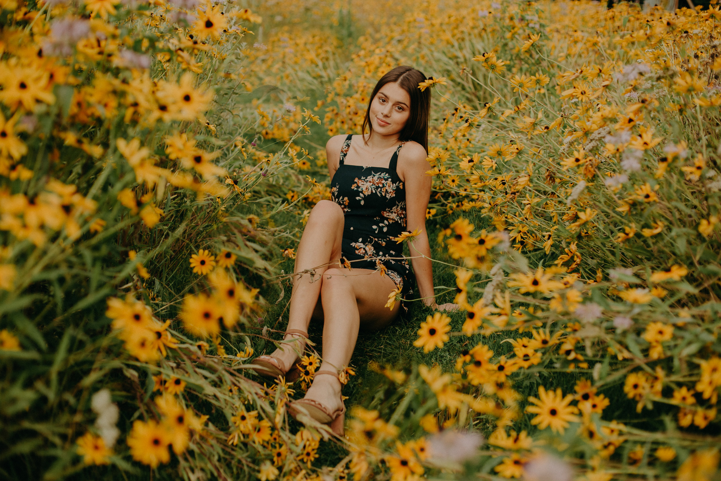 Andrea Wagner Photography captures epic moments in a bright yellow daisy field in Stillwater MN during senior photo shoot