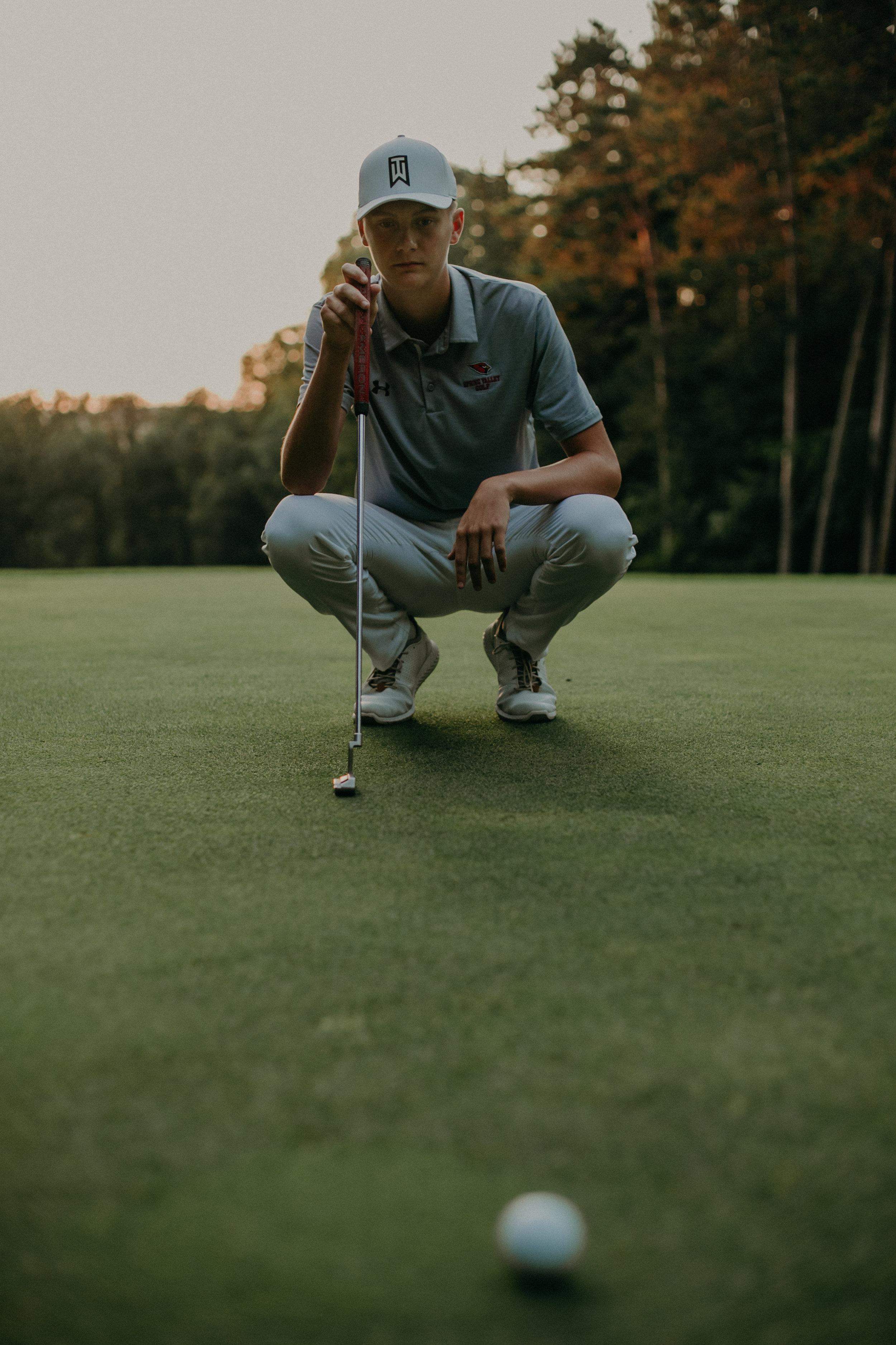 senior photoshoot on golf course in Spring Valley WI