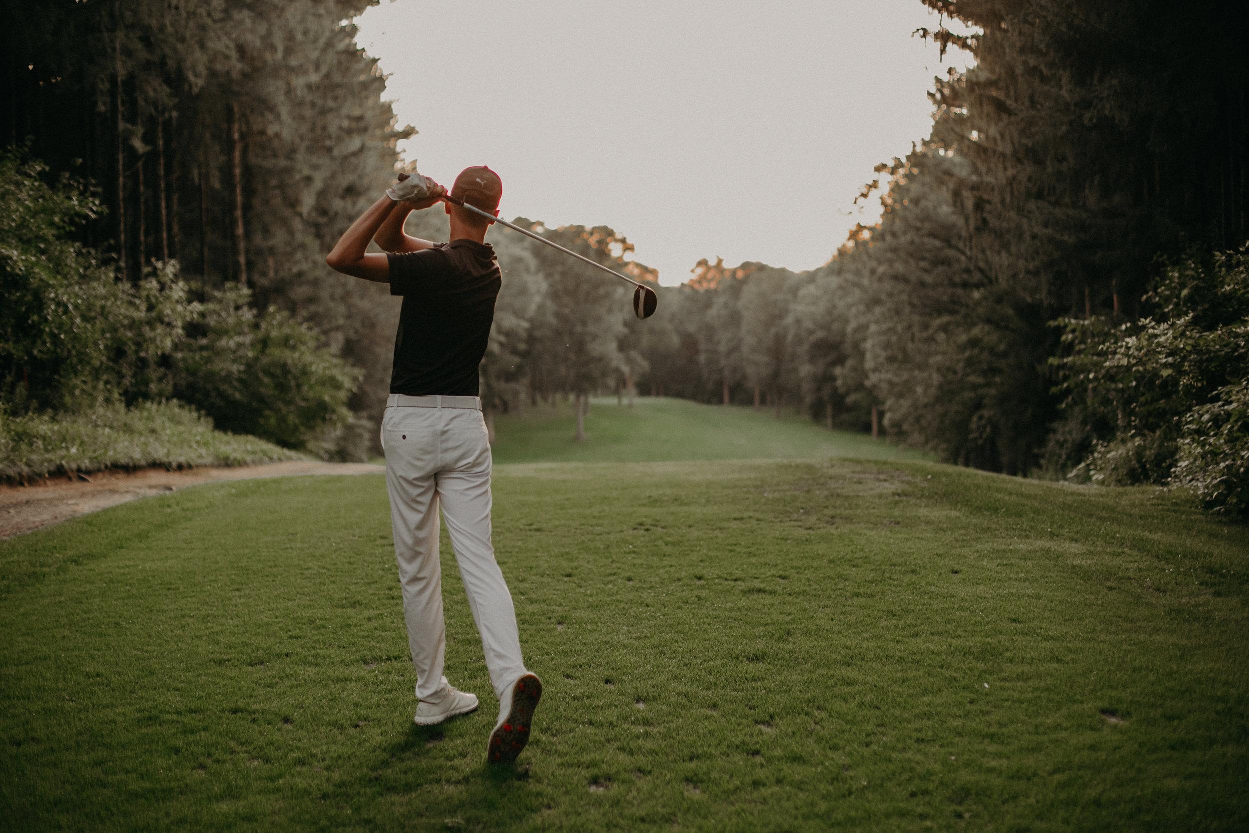 amazing senior photos of guy golfing at Wisconsin Golf course
