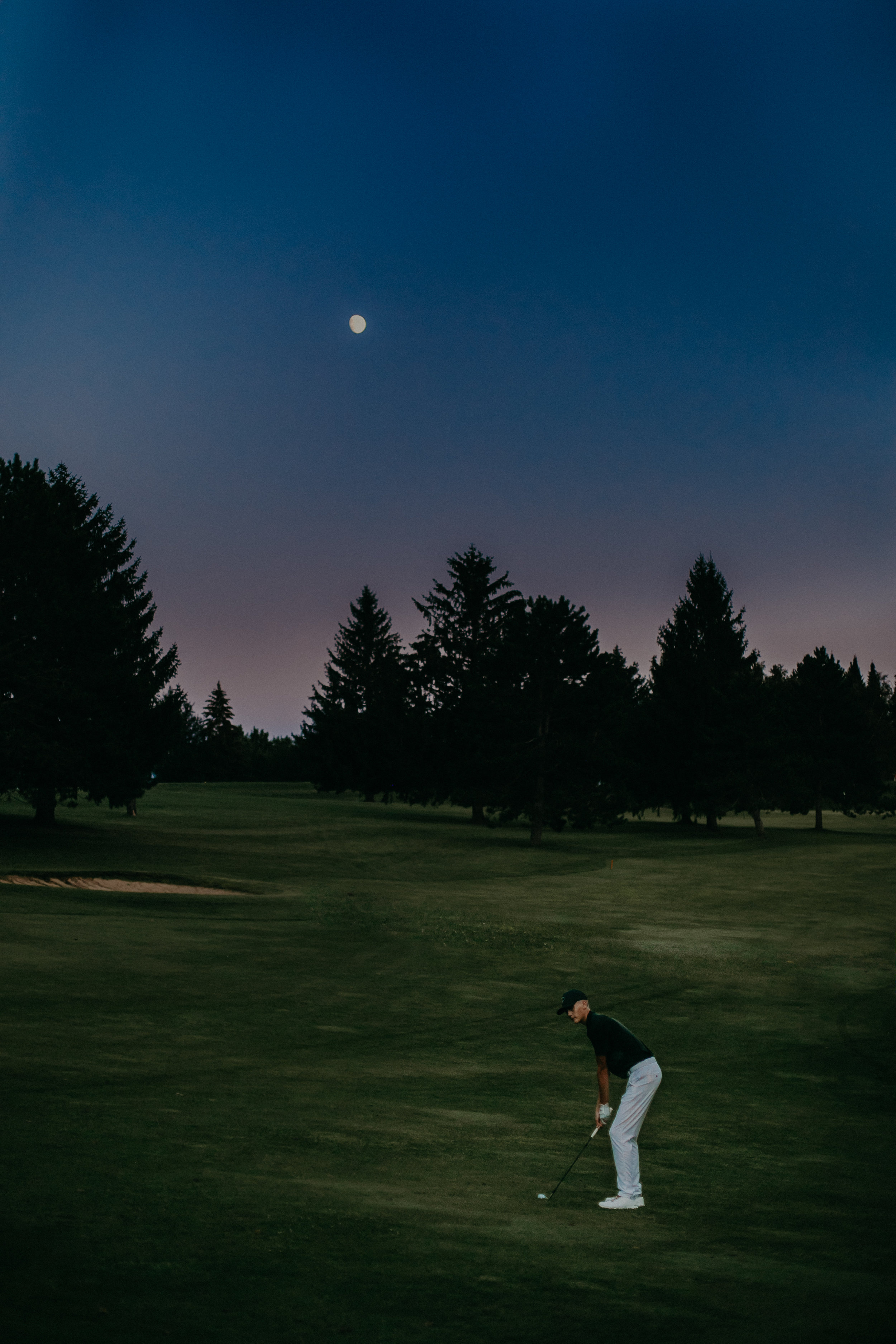 senior photo session on golf course in Spring Valley WI at full moon light