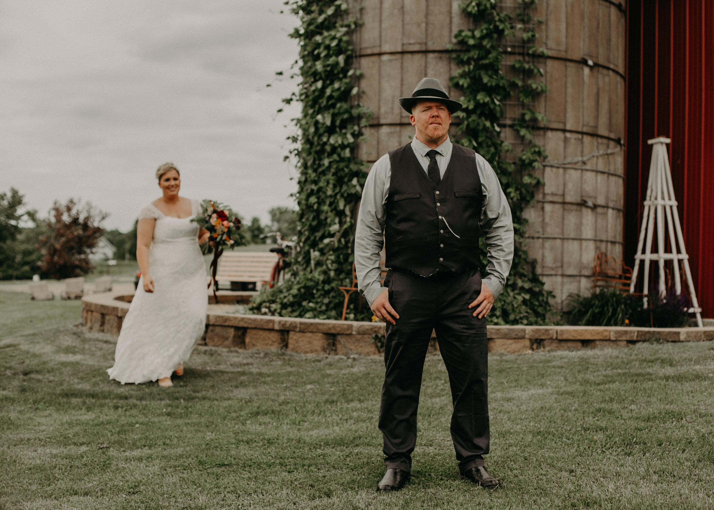 a wedding couple at Jean Acres in Ellsworth do a first look with Andrea Wagner Photography