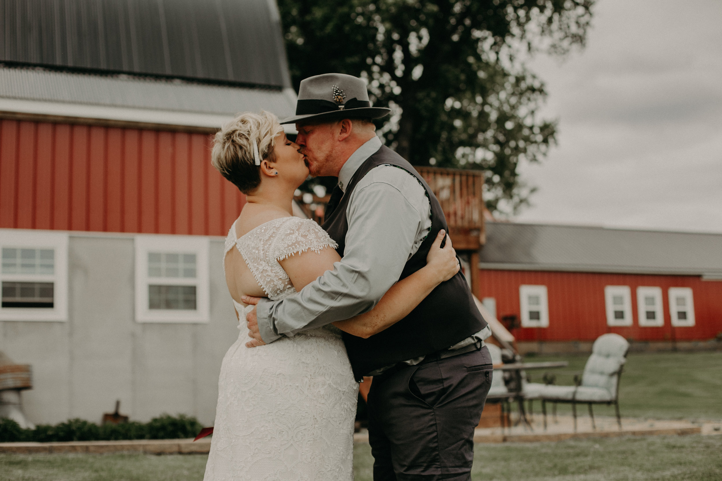 a couple kisses during their first look at their wedding in Ellsworth WI