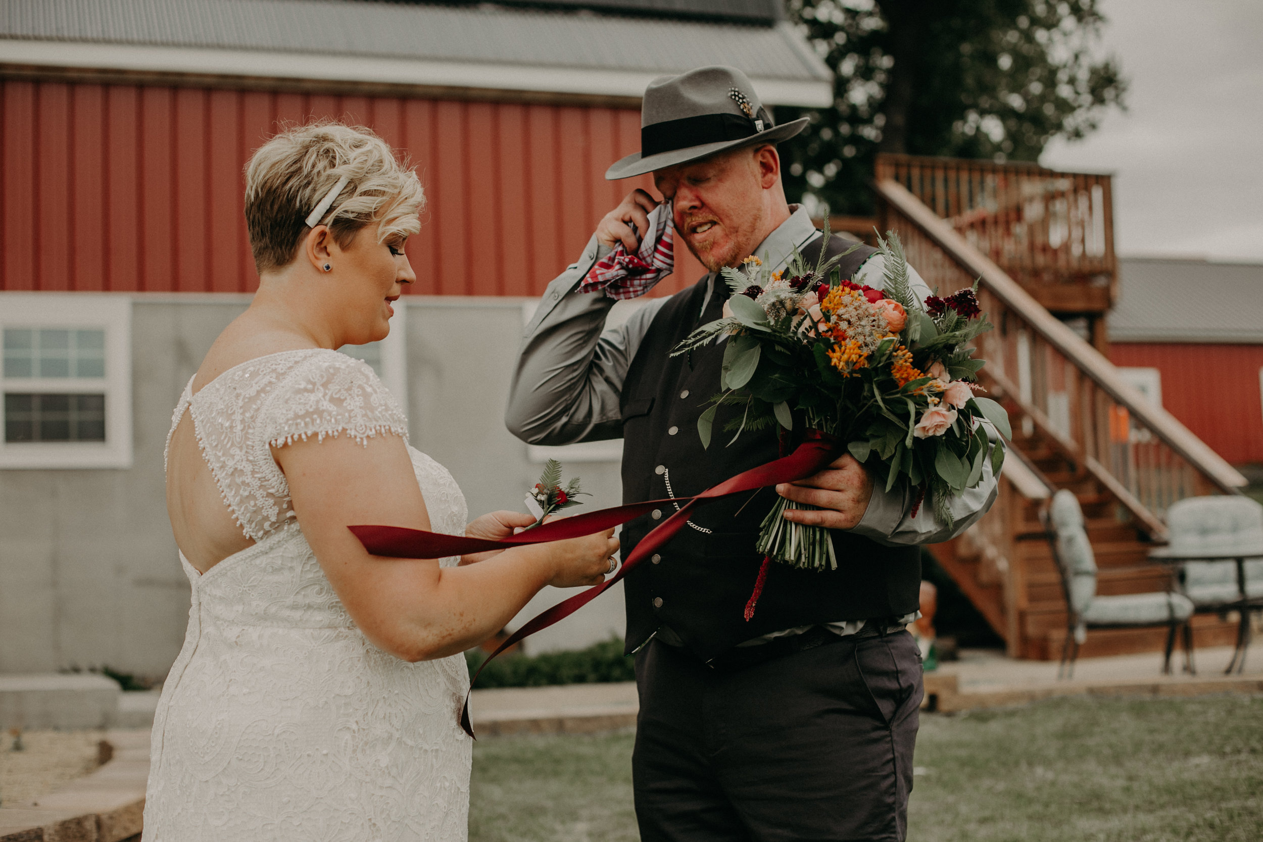 groom cries seeing his bride for the first time before their wedding at Jean Acres Barn in Ellsworth WI