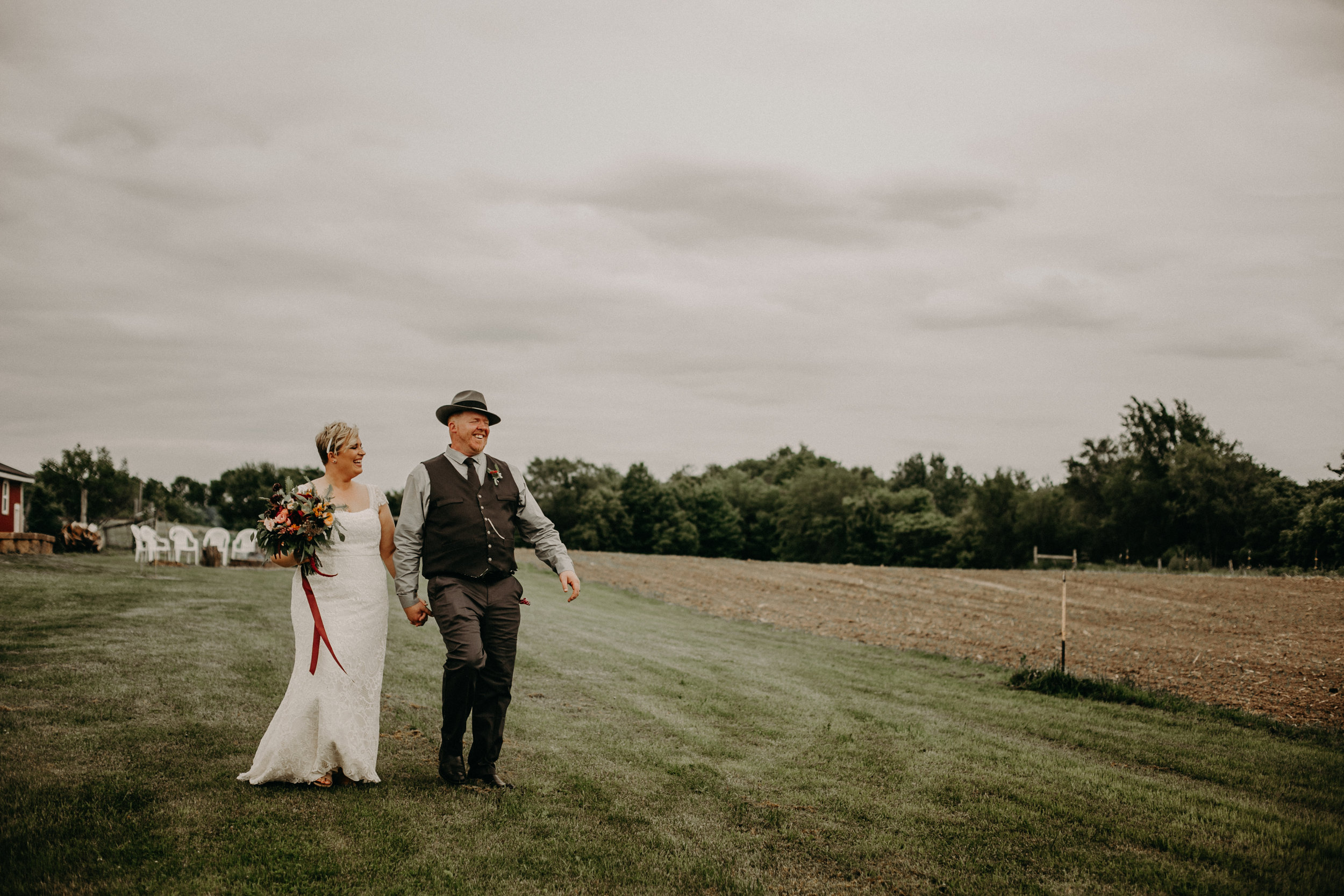 Andrea Wagner Photography provides wedding day photography in Ellsworth WI at Jean Acres Barn