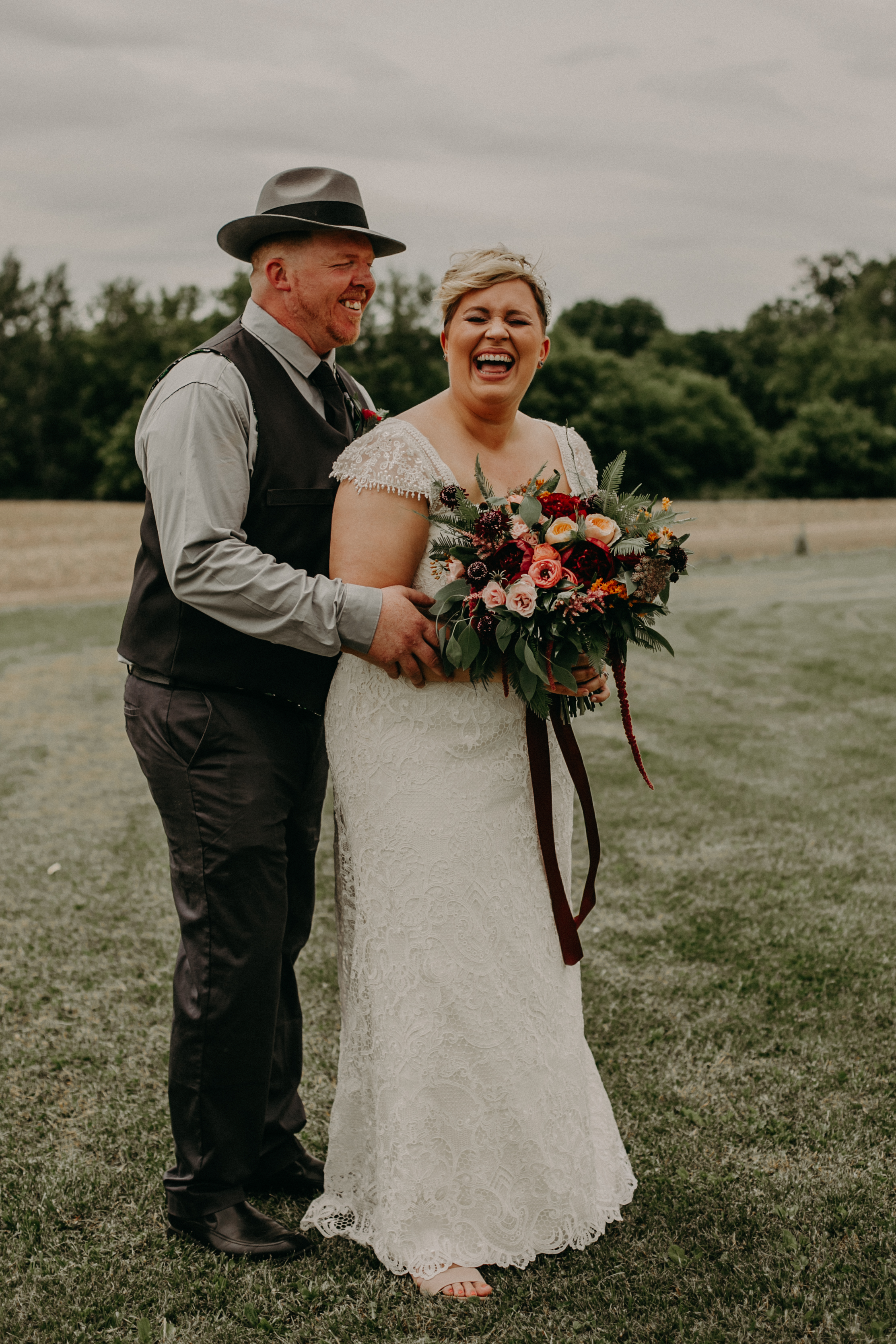 bride and groom laughing at their wedding at Jean Acres Barn in Ellsworth WI