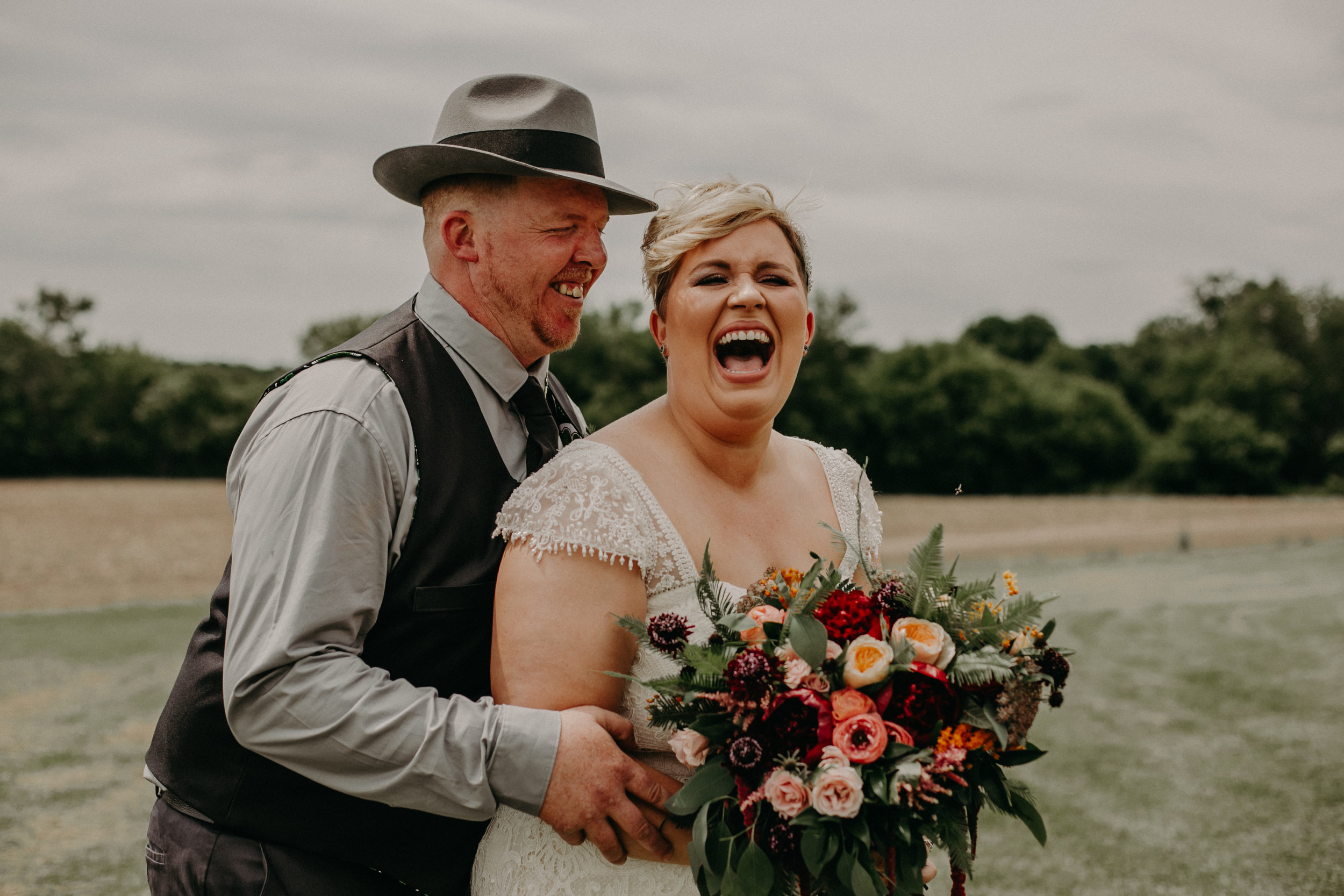 joyful and happy wedding day at Jean Acres Barn in Ellsworth WI captured by Andrea Wagner Photography