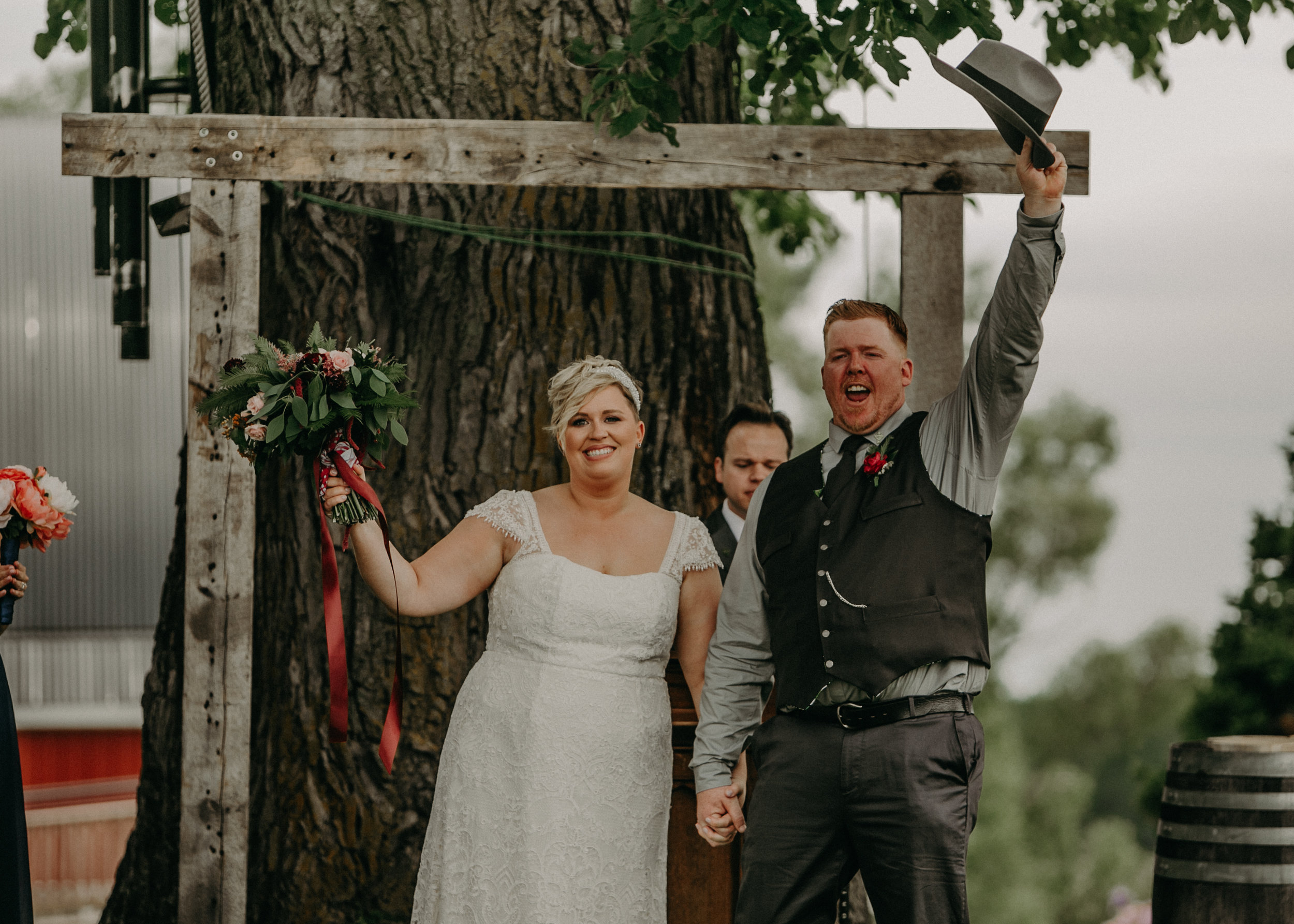 a bride and groom are married at Jean Acres Barn in Ellsworth WI
