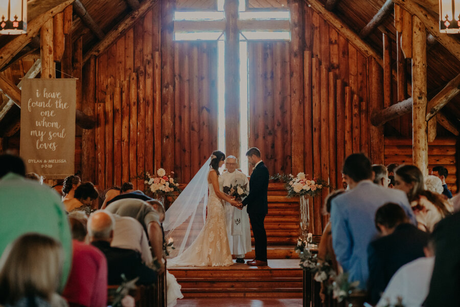 Melissa and Dylan repeat their vows in Waupaca WI during a lakeside wedding at Pine Lake Resort