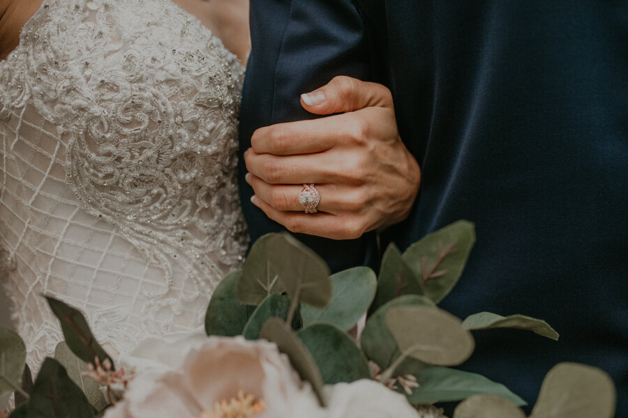 William Thomas jewelers wedding ring during a Waupaca wedding photographed by Andrea Wagner Photography